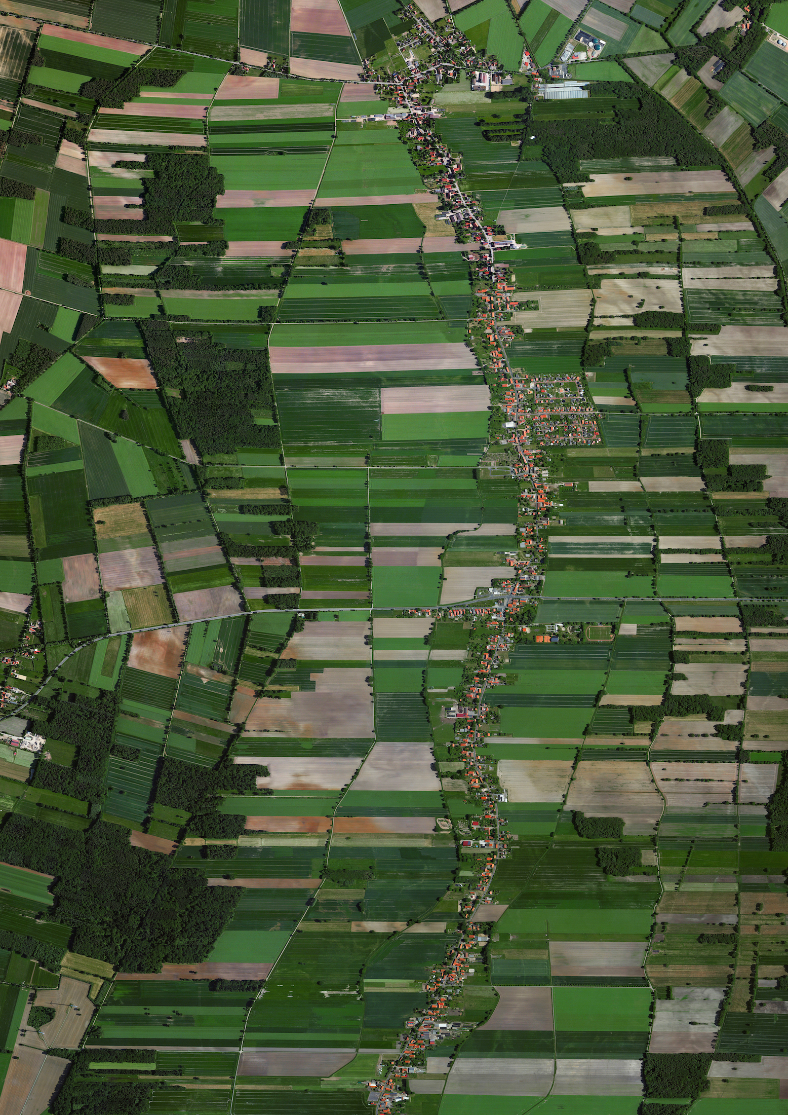 5/28/2016  Rodewald  Rodewald, Germany  52°39′57″N 09°28′56″E    Fields surround the residential area of Rodewald, Germany. The agricultural village was first mentioned in historical records from the early 13th Century and is now home to 2,549 people.