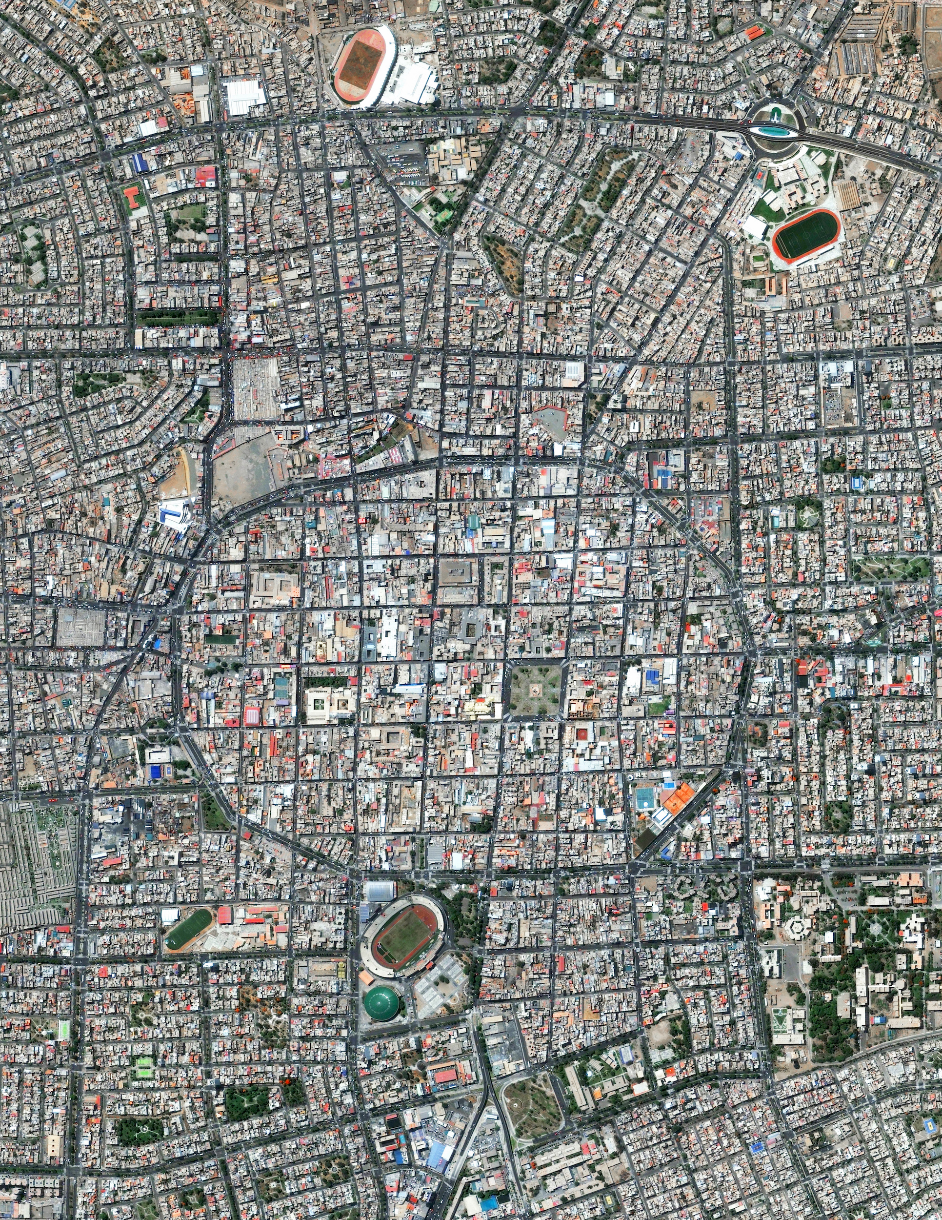 6/30/2016   Trujillo, Peru   8°6′43.2″S 79°1′43.68″W     Trujillo is the second largest city in Peru with slightly less than 800,000 residents in its urban area. España Avenue - the circular road that is visible at the center of this Overview - contains the city's monument area and also traces the historic outline of the defensive wall that was constructed around the city in 1786.