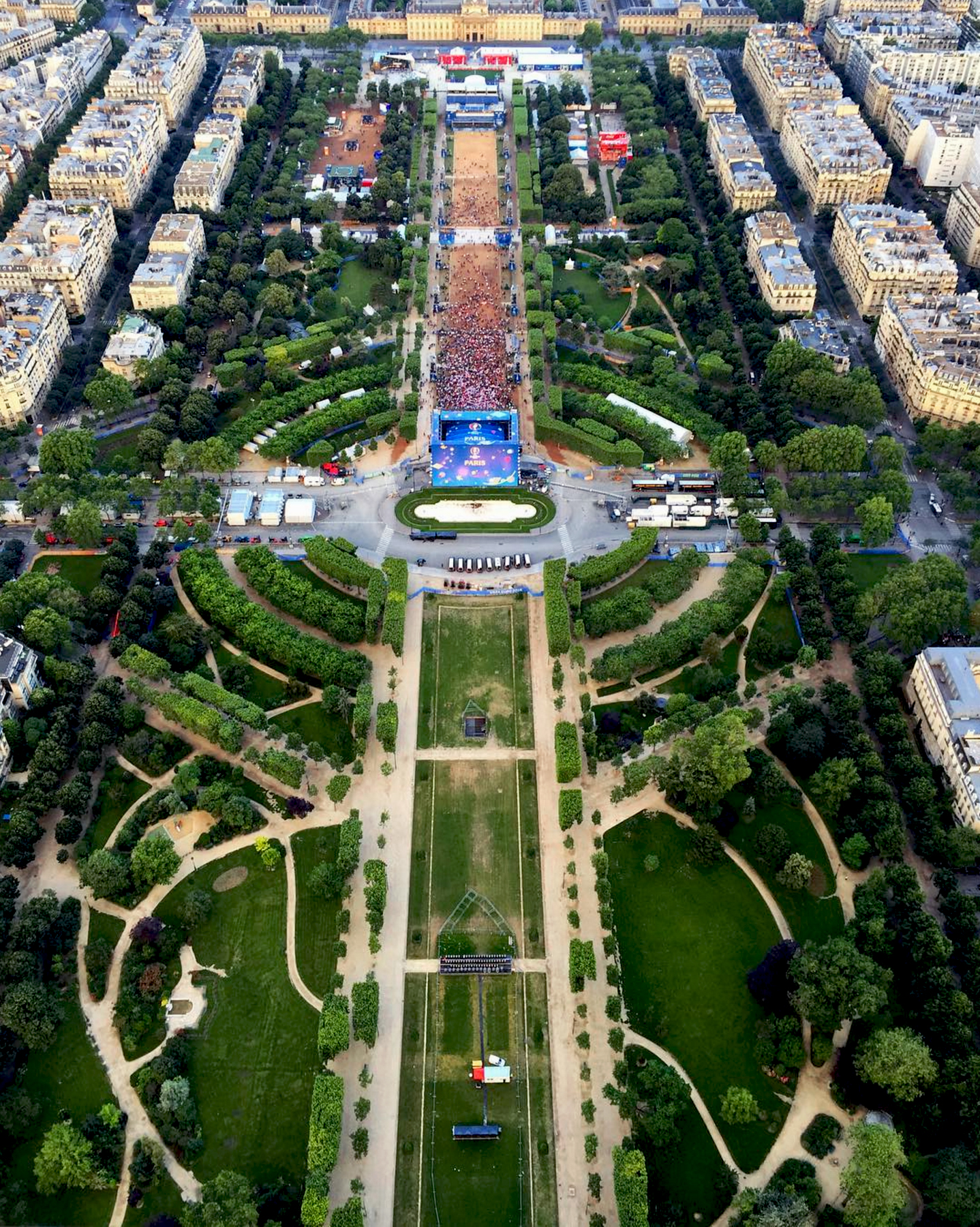 Check out this incredible overview from the top of the Eiffel Tower in Paris, France. This shot captures the Euro 2016 Fan Zone at Champ de Mars and was taken by our friend Kayla Bernardino. The quarterfinals of the tournament are currently underway with a match today between Wales and Belgium. If you are ever in Paris, the Eiffel Tower offers the highest vantage point in the city, rising 1,063 feet (324 meters).
