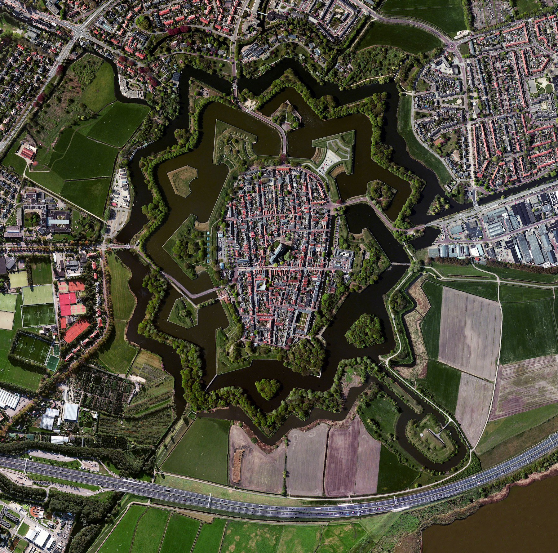 7/27/2016   Naarden   Naarden, Netherlands  52°18′N 5°10′E     Naarden is a star fort in the Netherlands. The city was constructed in the manner seen here so that an attack on any individual wall could be defended from the two adjacent star points by shooting at the enemy from behind. Today Naarden is home to roughly 17,000 residents.