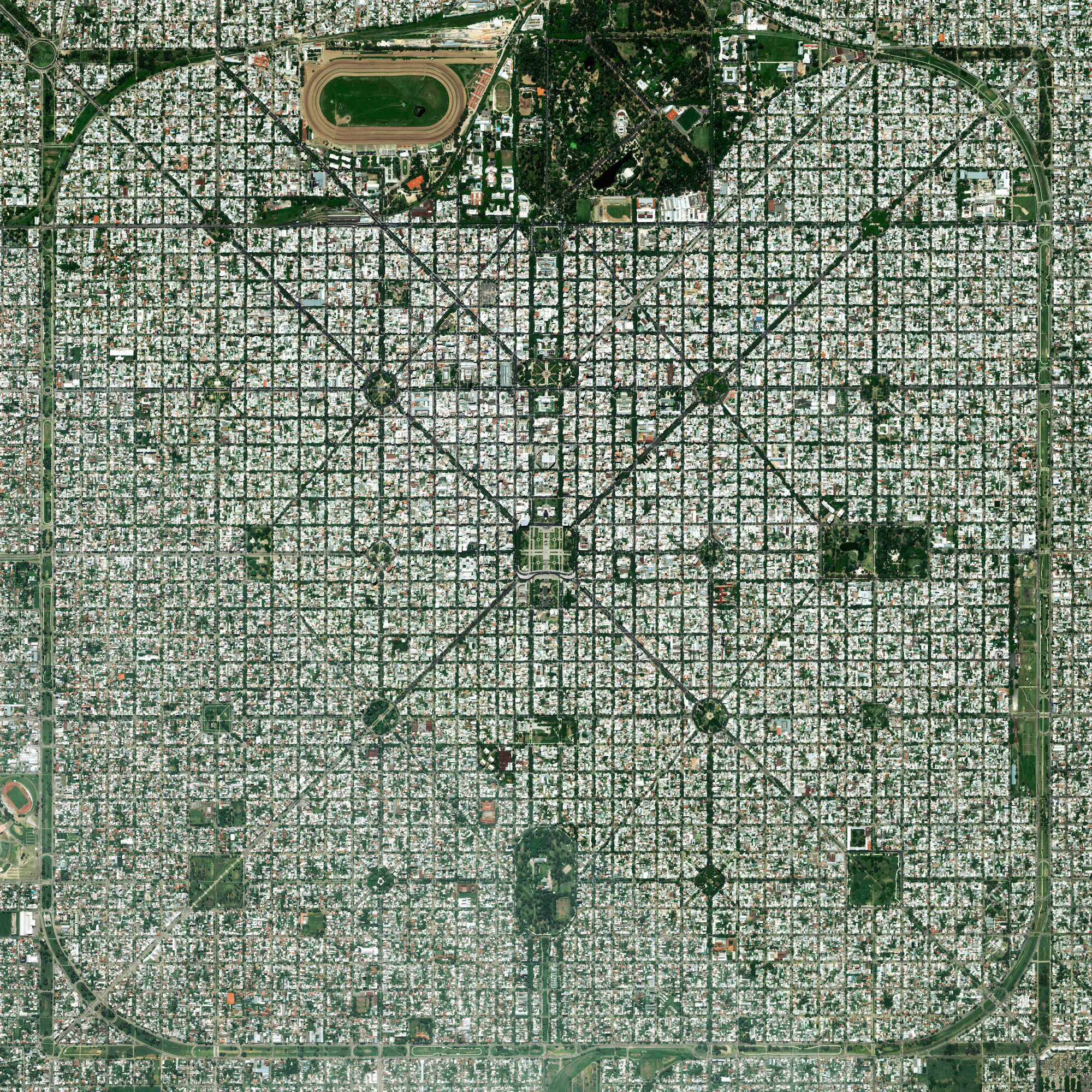 """8/26/2016   La Plata   Buenos Aires, Argentina   34°55′16″S 57°57′16″W     The planned city of La Plata, the capital city of the Province of Buenos Aires, is characterized by its strict grid pattern. At the 1889 World's Fair in Paris, the new city was awarded two gold medals for the """"City of the Future"""" and """"Better performance built."""" This is the fifth of seven posts in our week focused on urban planning."""