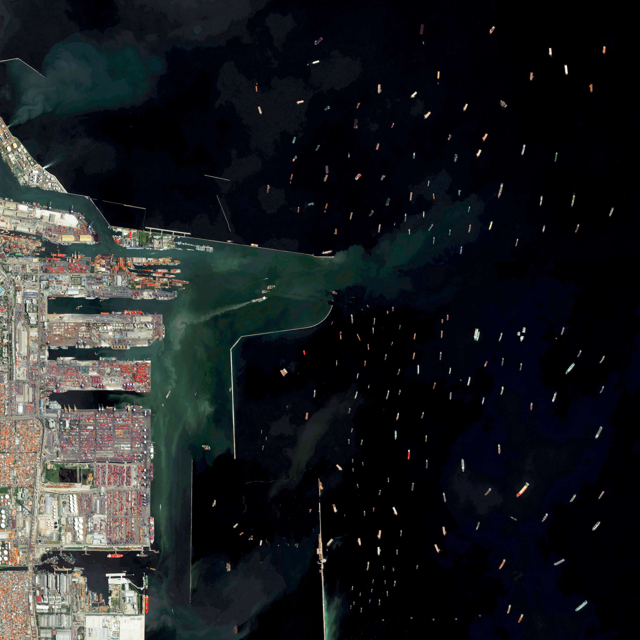 8/31/2016   Port of Tanjung Priok   Jakarta, Indonesia  6.104°S 106.8865°E    Dozens of massive cargo ships and tankers - some weighing up to 300,000 tons - are anchored outside the Port of Tanjung Priok in Jakarta, Indonesia. The facility is the country's busiest and most advanced seaport, handling more than 50% of Indonesia's trans-shipment cargo. The port is also among the least efficient in all of Southeast Asia, due to slow customs handling and limited docking capacity.