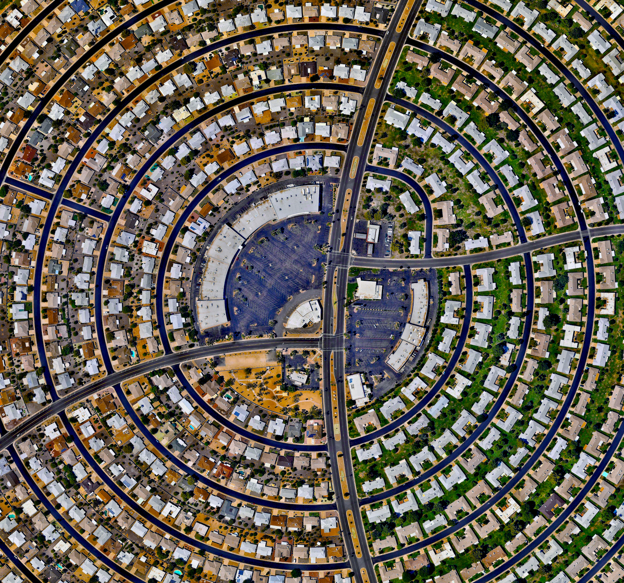 """9/23/2016   Sun City   Sun City, Arizona, USA  33.6189504, -112.291099    Houses, built in concentric circles, make up a section of Sun City, Arizona, USA. When the development opened on January 1, 1960, the event attracted a crowd of more than 100,000 onlookers and the """"futuristic development"""" was featured on the cover of Time magazine."""