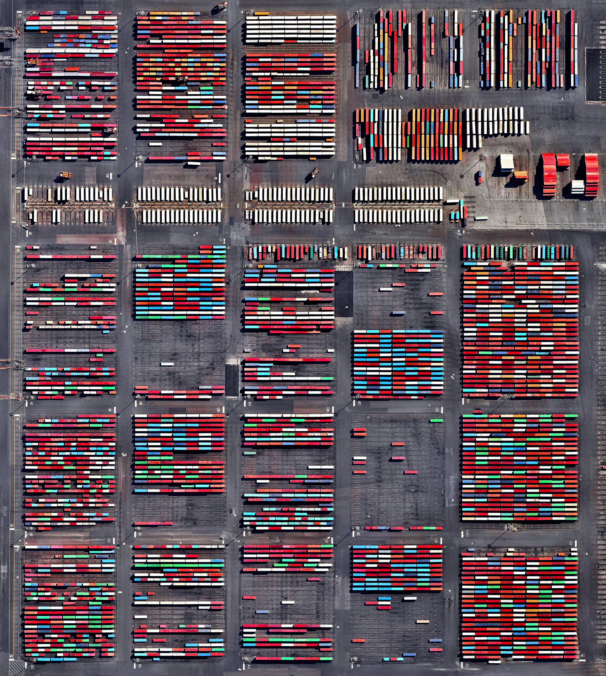 9/27/2016   Port Newark   Newark, New Jersey  40°40′54″N 74°09′02″W    Shipping containers are stacked at the Port Newark Container Terminal in Newark, New Jersey, USA. The massive facility handles over 600,000 shipping containers every year and has begun expansion projects that will increase annual capacity to 1.1 million containers by 2030.