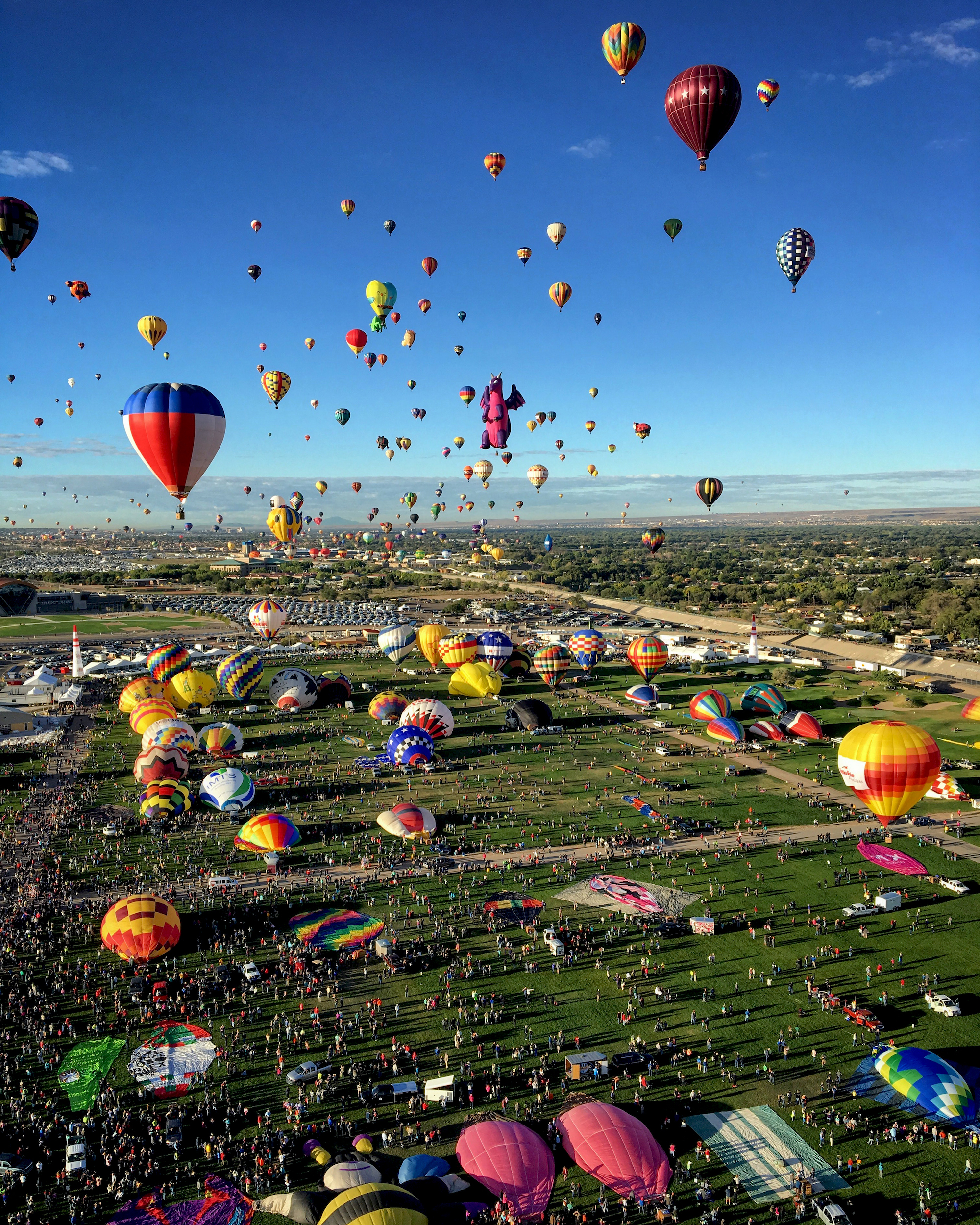 """10/5/2016   Albuquerque International Balloon Fiesta   Albuquerque, New Mexico, USA  35°11′46″N 106°35′51″W    The Albuquerque International Balloon Fiesta is currently underway in Albuquerque, New Mexico, USA. The annual, nine day event is the largest event of its kind in the world with more than 500 balloons. This incredible overview, captured by Alexandra Grumblatt, captures an event known as a """"mass ascension"""" when all participants launch in two waves, filling the sky with hundreds of balloons at once."""