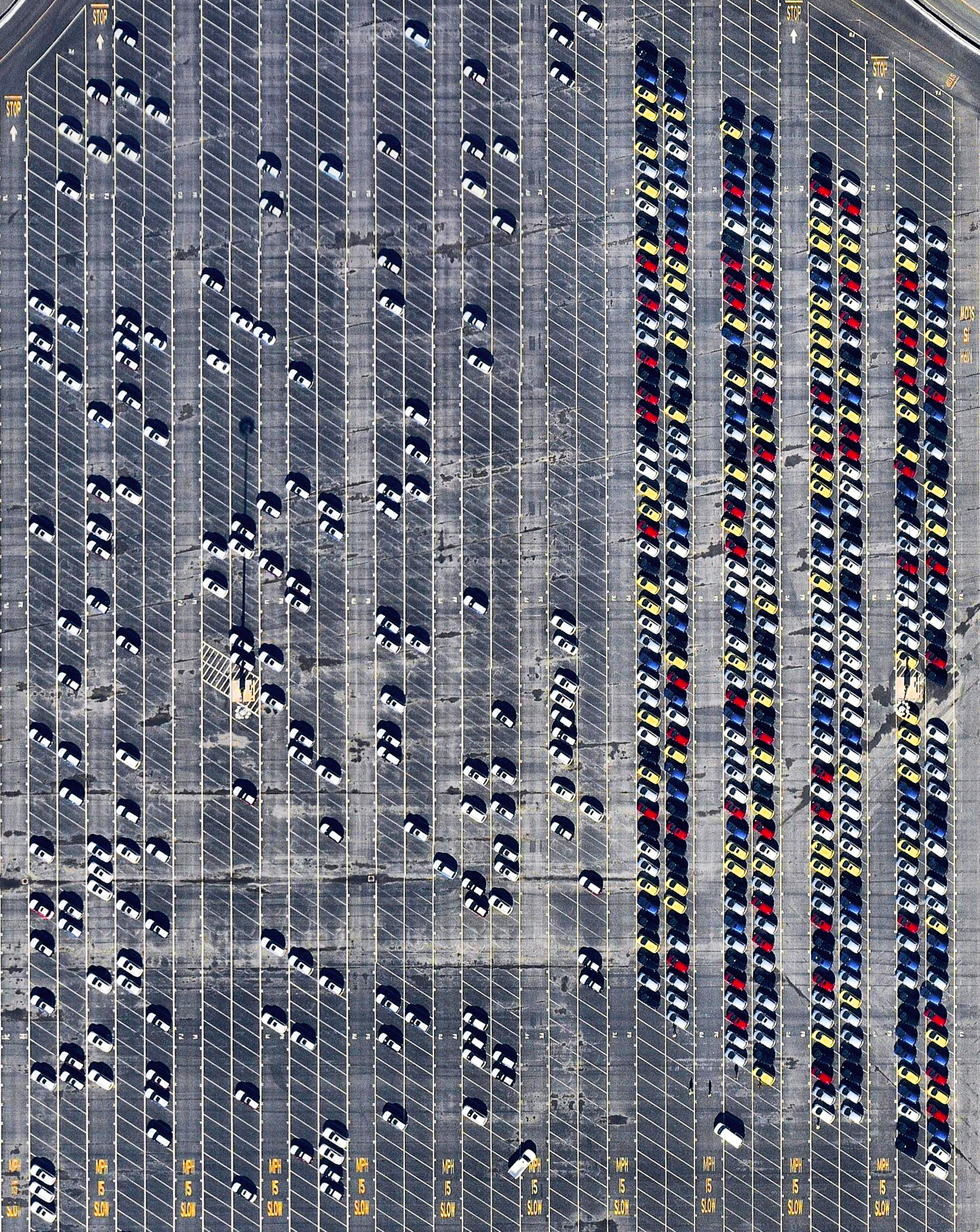 10/6/2016   Car terminal   Richmond, California, USA  37.9137118, -122.368161    Cars are unloaded and parked at an automobile terminal in Richmond, California, USA. In 2015, 17.5 million cars and light trucks were sold in the United States, raising the total number of registered vehicles in the country to roughly 253 million.  Source imagery: Nearmap
