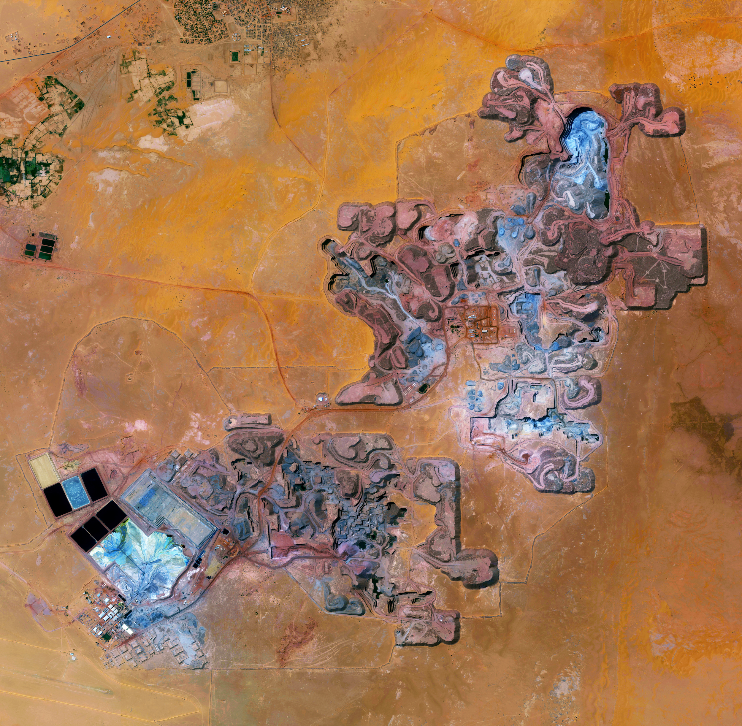 """10/22/2016  Arlit Uranium Mine  Arlit, Niger  18°44′N 7°23′E    With just three days until the release of """"Overview"""", I'm sharing a few of my favorite images from the book. Here's one from the chapter all about mining, 'Where We Extract'. The Arlit Uranium mine is located in Arlit, Niger. French nuclear power generation as well as the French nuclear weapons program are dependent on the uranium that is extracted from the mine - more than 3400 tonnes per year."""