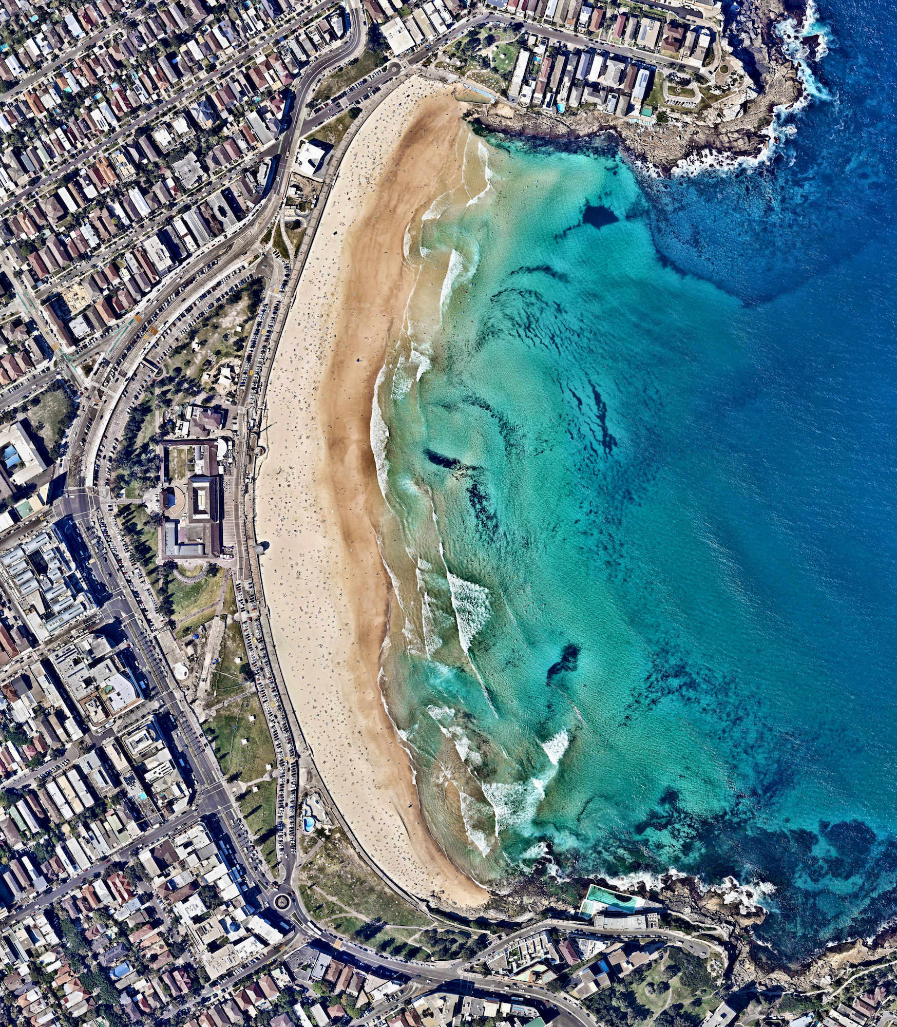"""11/12/2016  Bondi Beach  Sydney, Australia  33°53′28″S 151°16′40″E    Bondi Beach and its surrounding suburb are located in Sydney, Australia. One of the city's most stunning and popular destinations, the beach gets its name from the Aboriginal word """"Bondi"""" that means waves breaking over rocks.  Source imagery: Nearmap"""