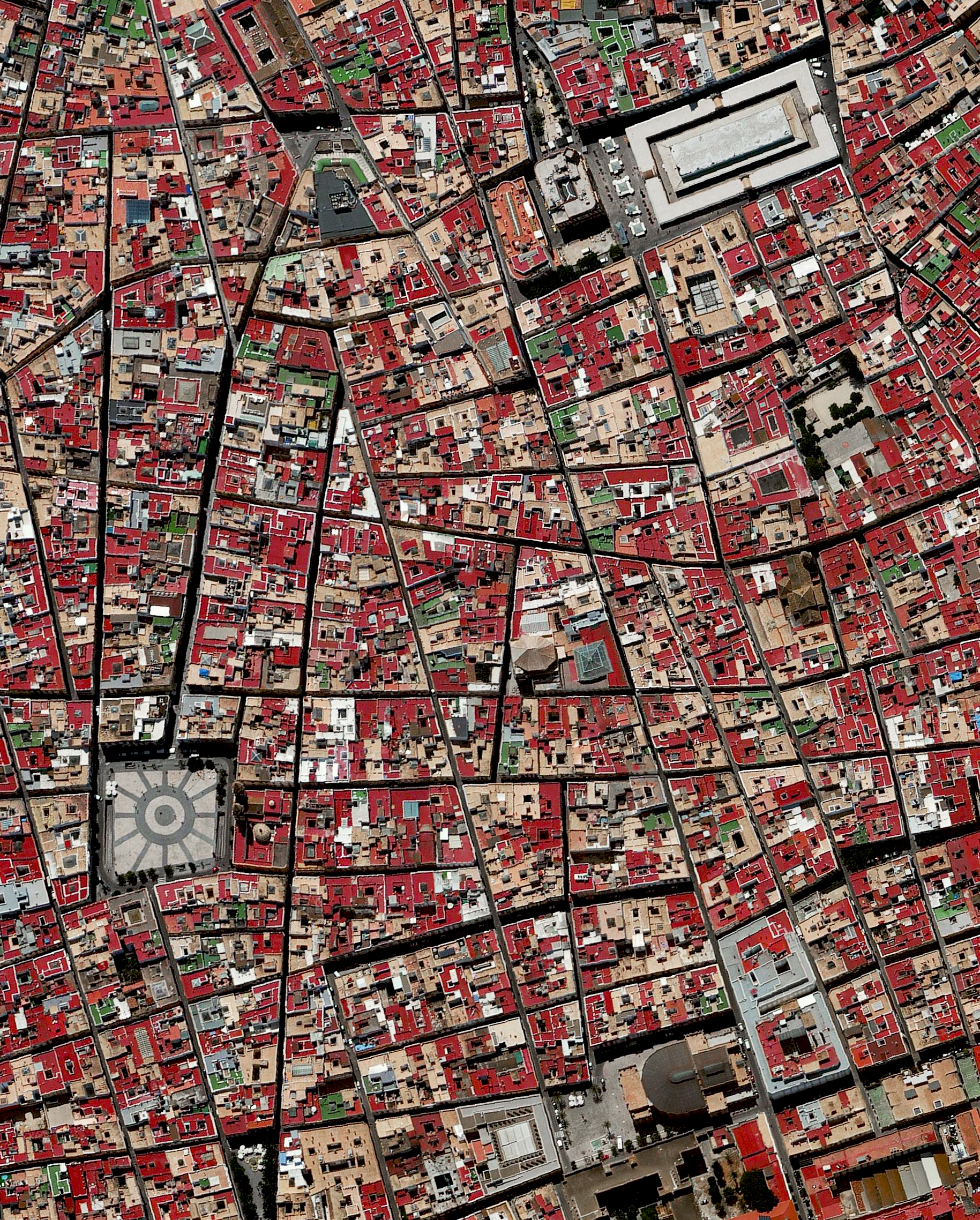 """11/14/2016   Cadiz   Cadiz, Spain  36.531514, -6.299827    Cádiz is an ancient port city surrounded by the sea in southwest Spain. Because the city was constructed upon a spit of land that cannot support high-rises, its skyline has not substantially changed since medieval times. A portion of the """"Old City"""" — an area characterized by narrow winding alleys connecting large plazas and markets — is seen in this Overview."""