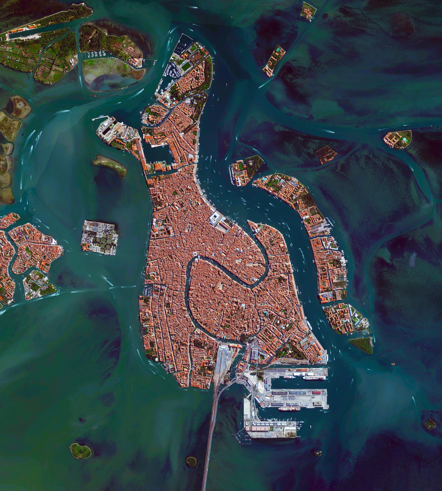 """11/17/2016  Venice  Venice, Italy  45.440995°, 12.323397°    Here's one of my favorite images from  """"Overview""""  - Venice, Italy. The city is situated upon 118 small islands that are separated by canals and linked by bridges. With its tide waters expected to rise to perilous levels, the city has constructed 78 giant steel gates across the three inlets, through which water from the Adriatic could surge into Venice's lagoon. The panels – which weigh 300 tonnes and are 92 feet (28 meters) wide and 65 feet (20 meters) high – are fixed to massive concrete bases dug into the seabed."""
