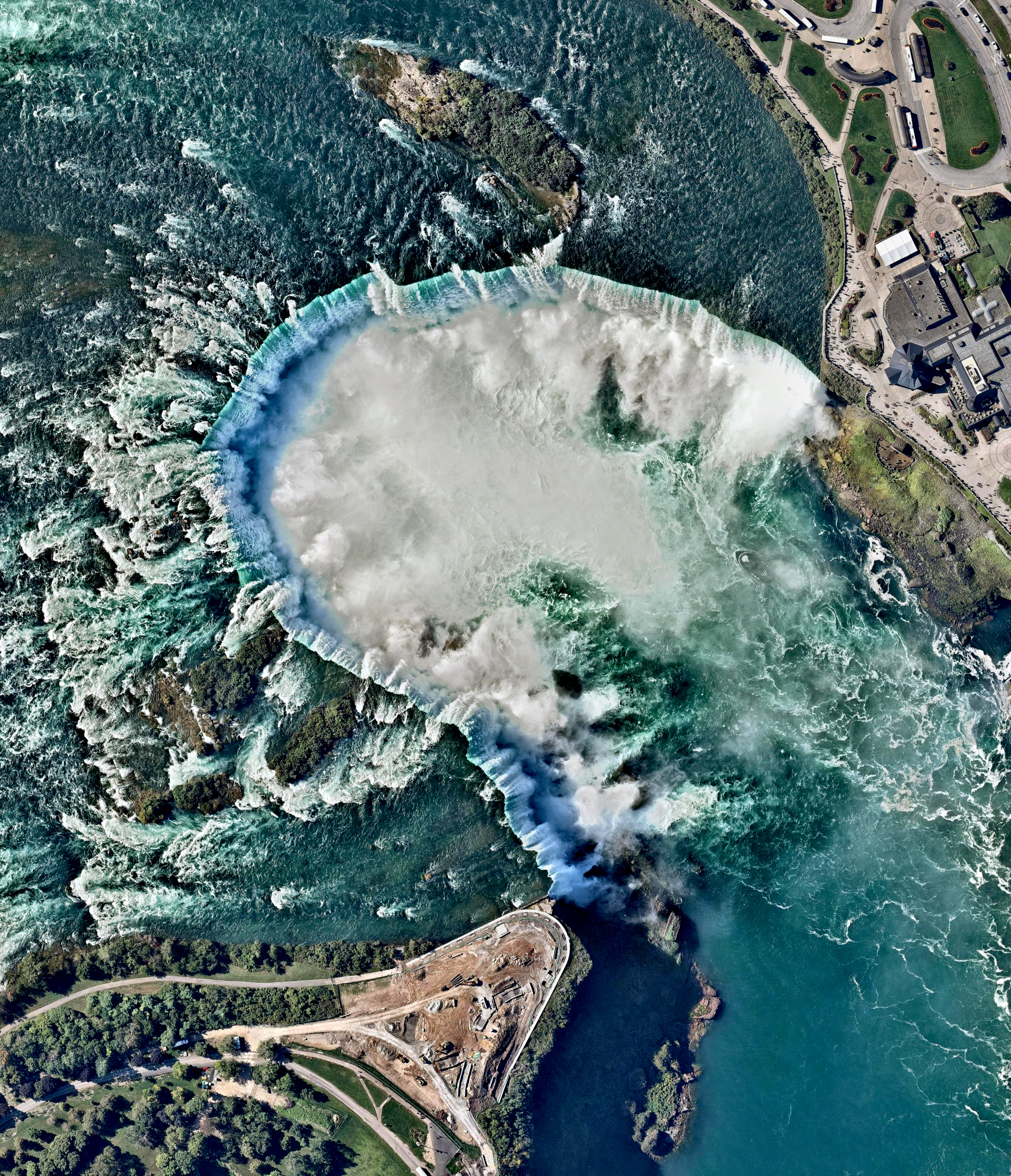 Continuing with our favorite Overviews of 2016, here is one from October of Niagara Falls — the collective name for three waterfalls that straddle the border between Ontario, Canada and the United States. Horseshoe Falls is seen here. The falls have the highest flow rate of any waterfall in the world, with a vertical drop of more than 165 feet (50 m). The Maid of the Mist, also visible here, is a boat that has carried passengers into the rapids below the falls since 1846.  Source imagery: Nearmap