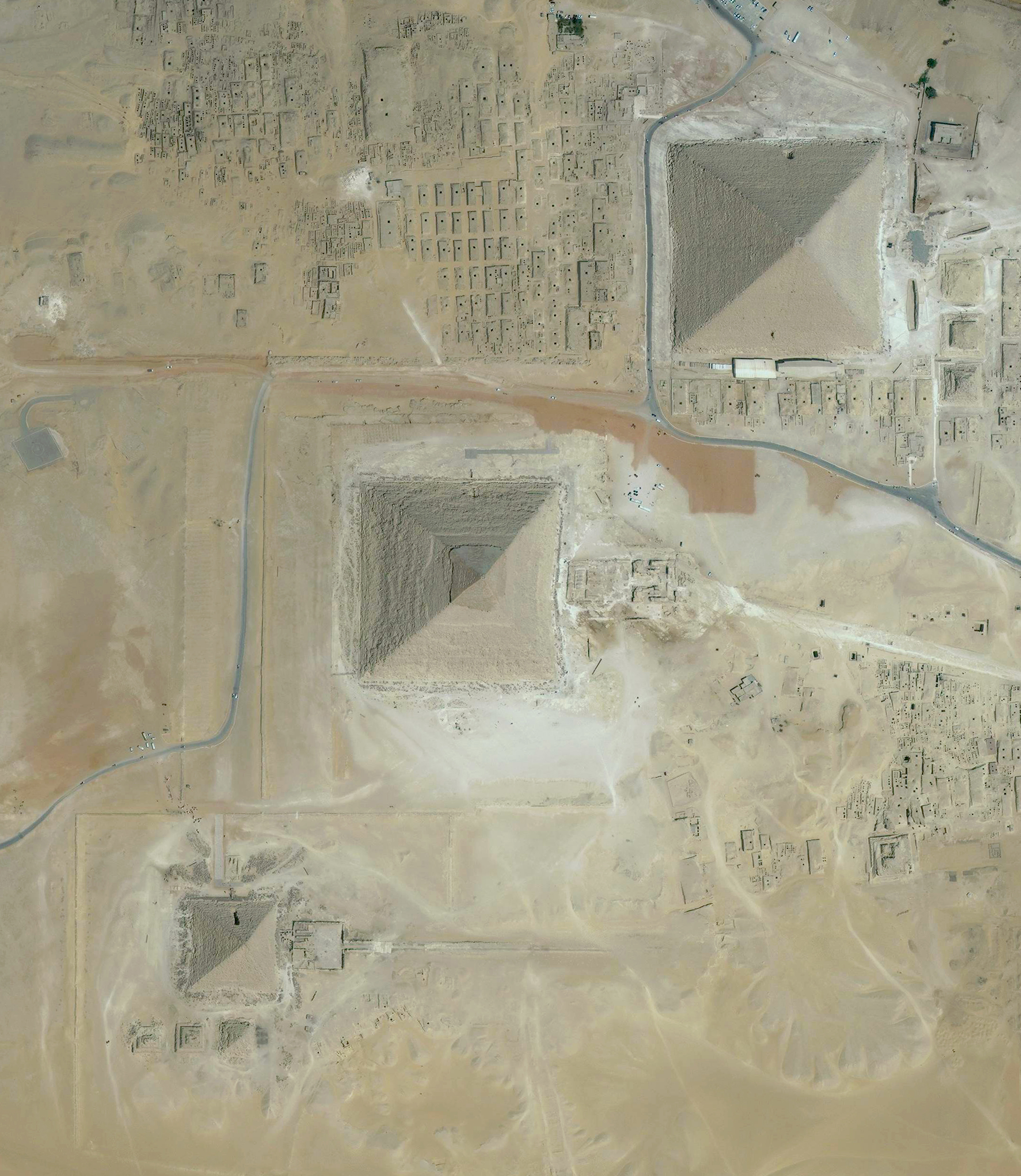 3/10/2017   Great Pyramids of Giza   Giza, Egypt  29.979234, 31.134201    The Great Pyramids of Giza are located on the outskirts of Cairo, Egypt. Dating back to 2580 BC, the Great Pyramid, the largest structure at the site, is the oldest of the Seven Wonders of the Ancient world and the only one to remain largely intact. With an estimated 2,300,000 stone blocks weighing from 2 to 30 tons each, the 481 foot pyramid was the tallest structure in the world for more than 3,800 years.