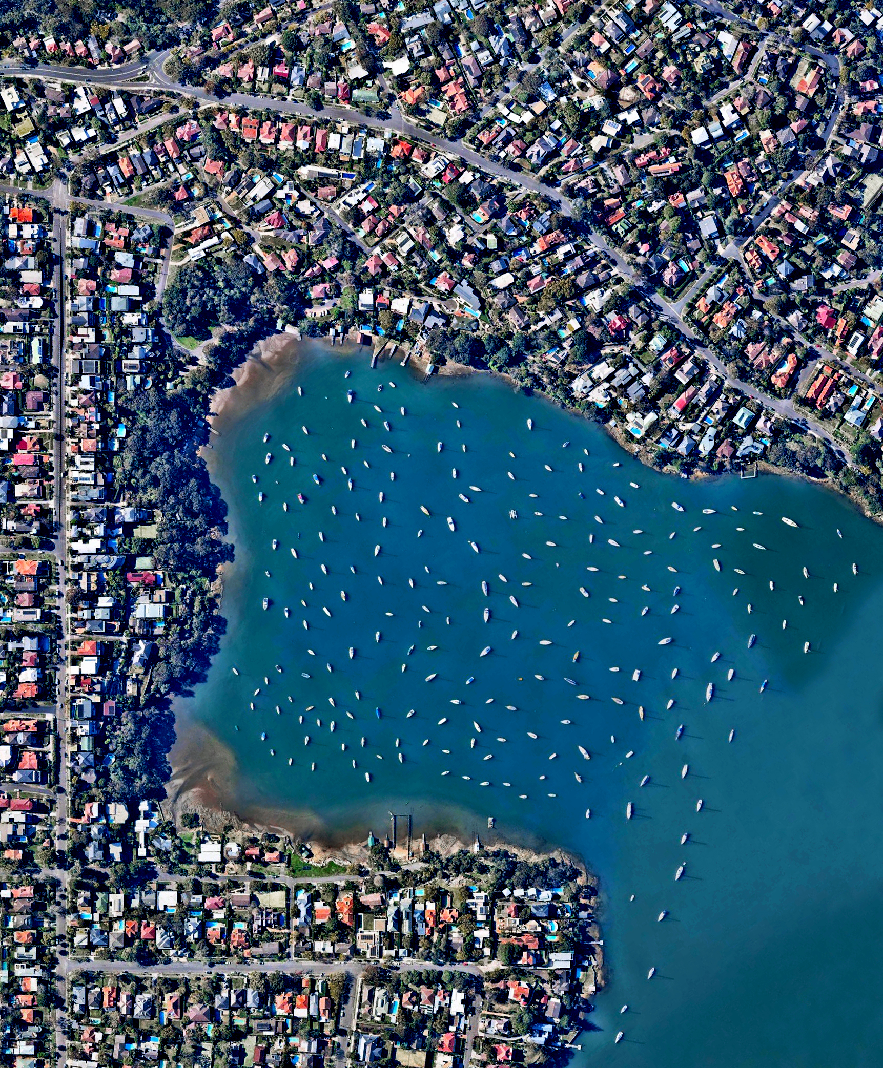 3/17/2017  Woodford Bay  New South Wales, Australia  -33.8298731,151.1739571    Sailboats are moored in Woodford Bay, New South Wales, Australia. Thousands of boats like the ones seen here are stationed in the channels and around the islands in the greater Sydney area. Wherever you are in the world, we hope you have a peaceful, fantastic weekend!
