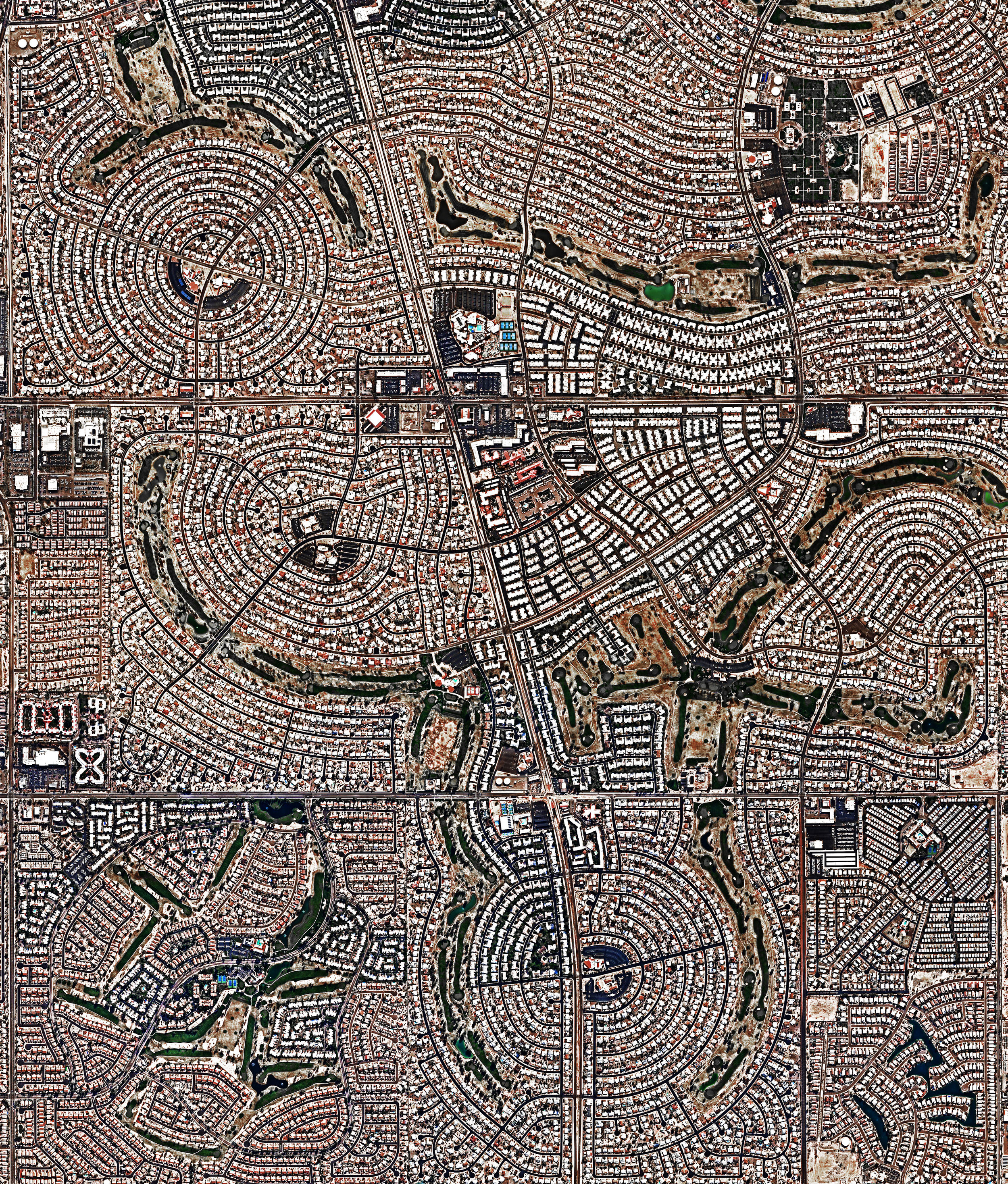 4/26/2017  Sun City  Sun City, Arizona, USA  33.624205, -112.285054  Sun City, Arizona, USA opened as a retirement community on January 1, 1960. That day, more than 100,000 people showed up to see the new development, resulting in a cover story in Time magazine. The community was built on the old ghost town of Marinette and covers 14.6 square miles. Today, Sun City has a population of roughly 37,000 people.  Source imagery: NearMap