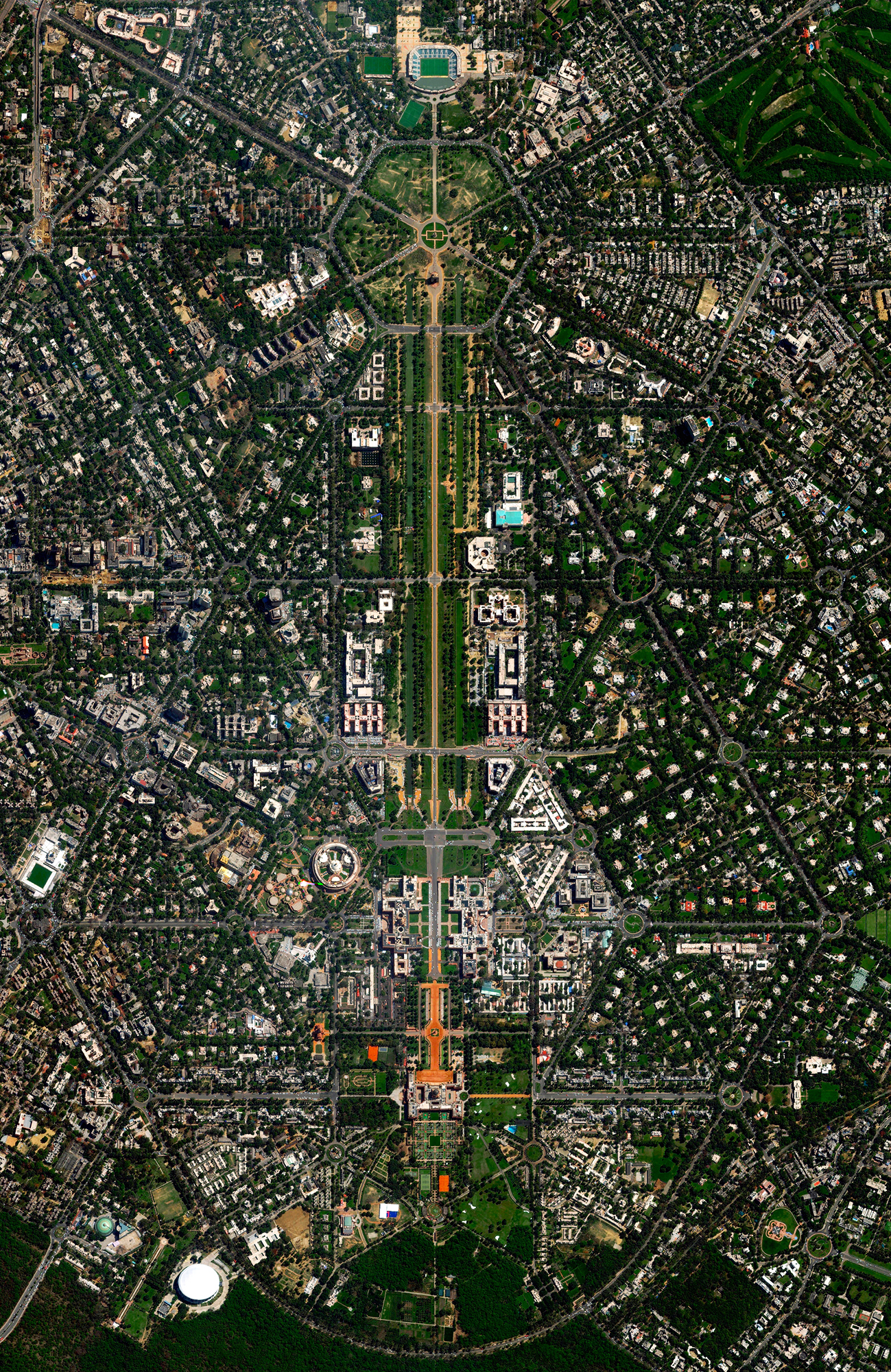 5/7/2017  New Delhi  Delhi, India  28.615593, 77.209023  New Delhi serves as the capital of India and is home to more than 21 million residents in its metro area. Officially inaugurated in February 1931, the city was planned by British architects Sir Edwin Lutyens and Sir Herbert Baker. Their design centered around two promenades - the Rajpath and the Janpath - that run perpendicular to each other and intersect here at center.  Source imagery: DigitalGlobe