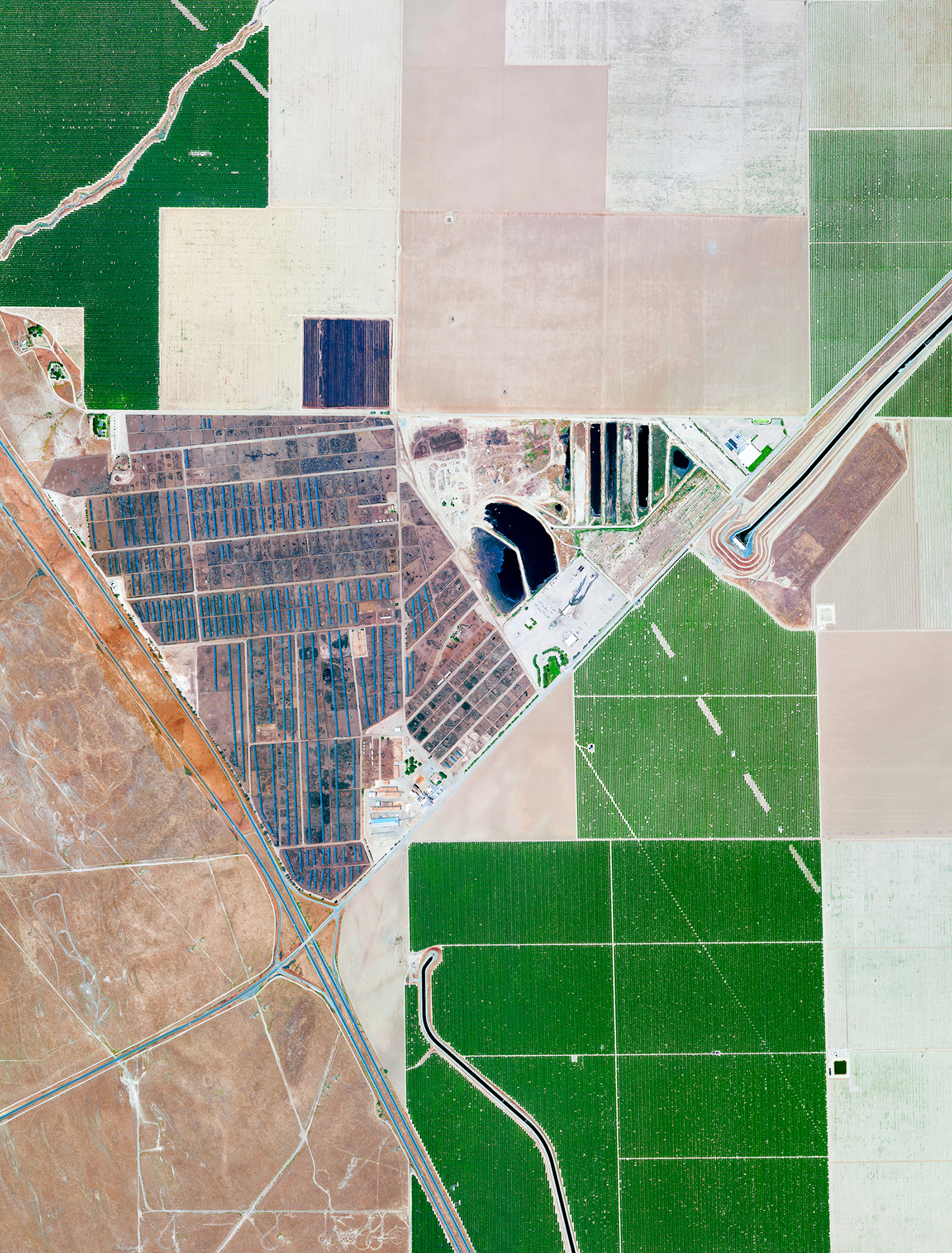 5/29/2017  Harris Cattle Ranch  San Joaquin Valley in California  36.305402, -120.258655     Harris Cattle Ranch is located in the San Joaquin Valley in California. Spanning 800 acres with a a cattle population of over 100,000, the facility produces 150 million pounds of beef per year, making it the largest beef producer on the West Coast of the United States.