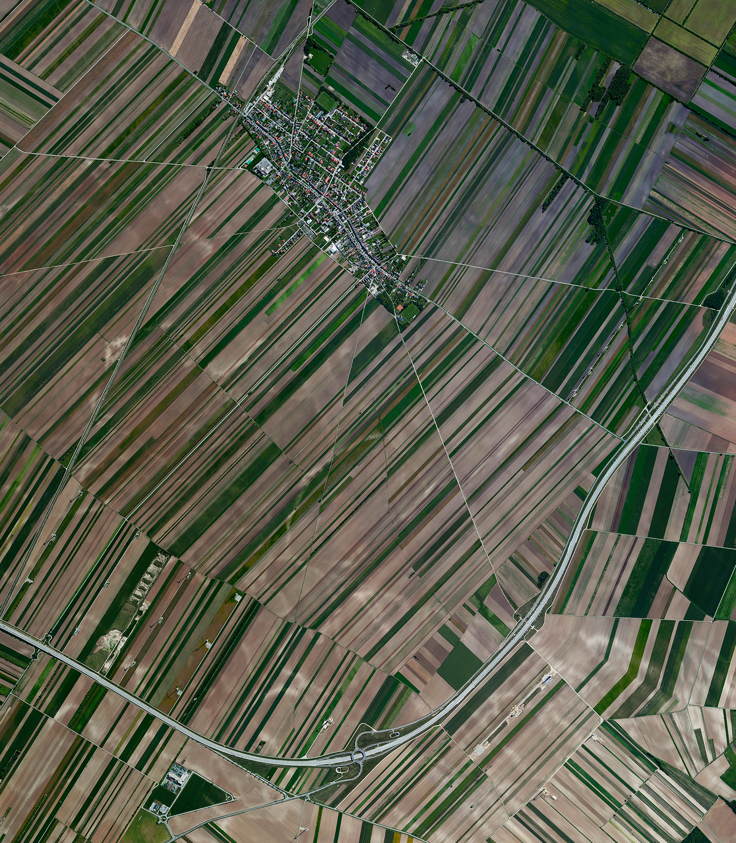 6/7/2017  Pama, Austria  48.047364, 17.034543  Agricultural development is seen around the village of Pama, Austria. The area has a population of roughly 1,100 and primarily produces wheat, rye, oats, and barley.