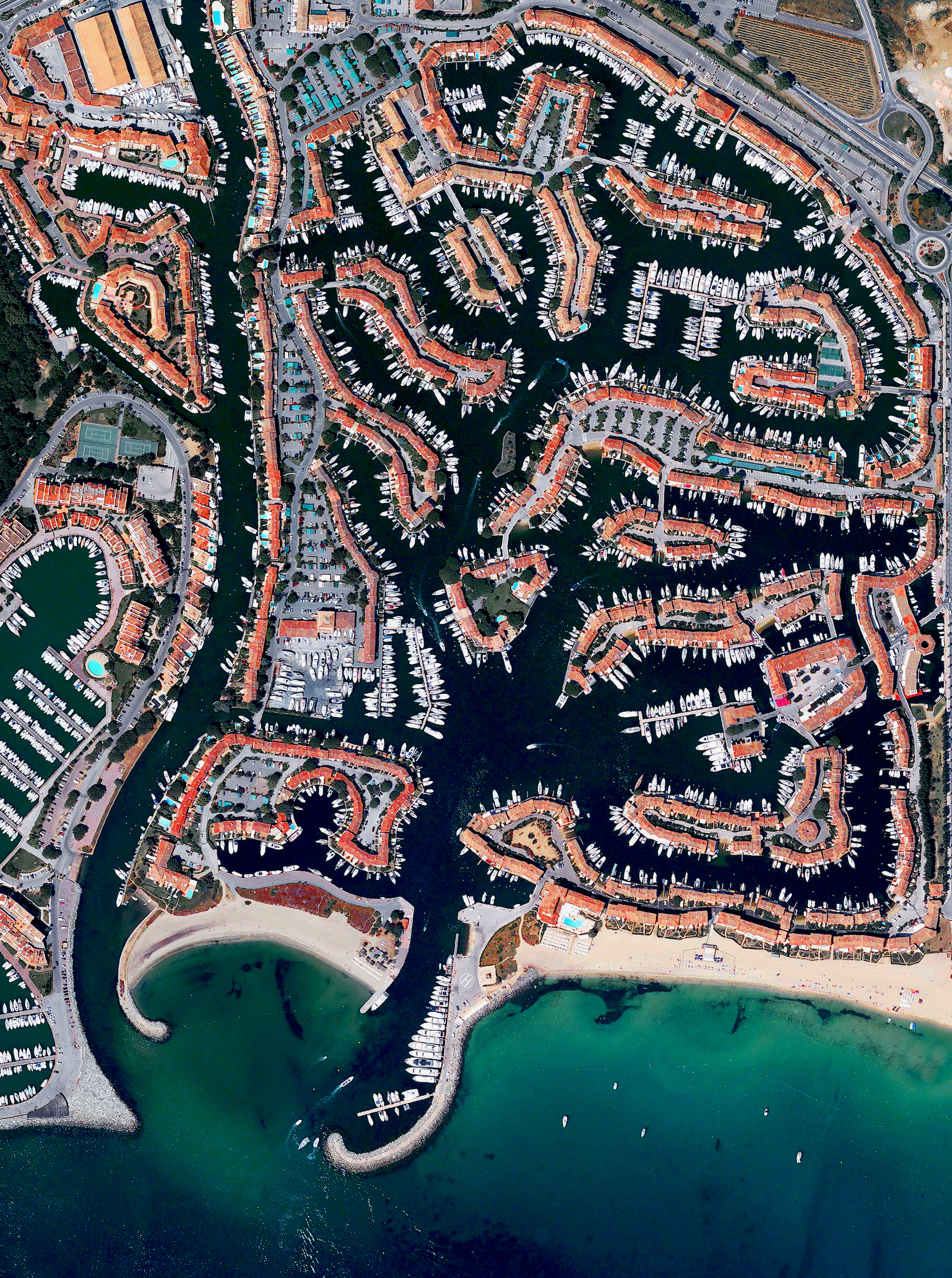 """6/19/2017  Port Grimaud  43°16′20″N 6°34′49″E    Port Grimaud is a seaside town located on the French Riviera by the Gulf of Saint Tropez. The development consists of French """"Fisherman"""" style houses built upon channels in a Venetian manner."""