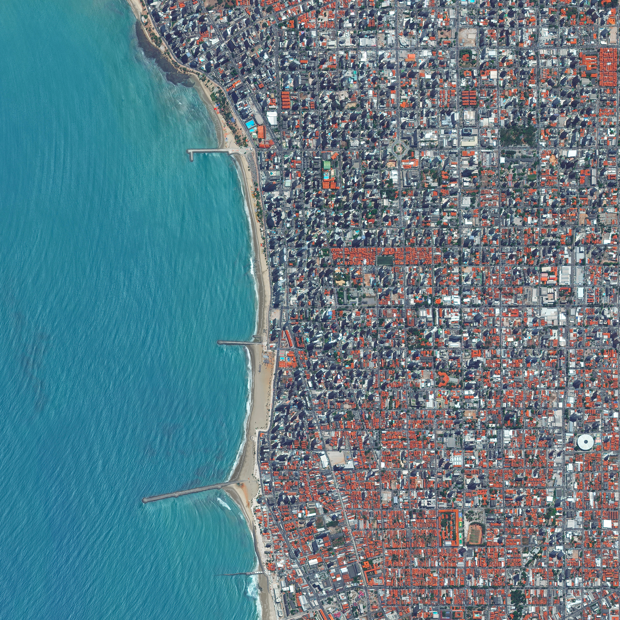 Waves rolls into the coast of Fortaleza, Brazil. Located on the Atlantic Ocean, Fortaleza has nearly 25 kilometers (16 miles) of urban beaches.The city serves the state capital of Ceará in the northeast of the country and is home to roughly 2.3 million people.  3°43′6″S 38°32′34″W