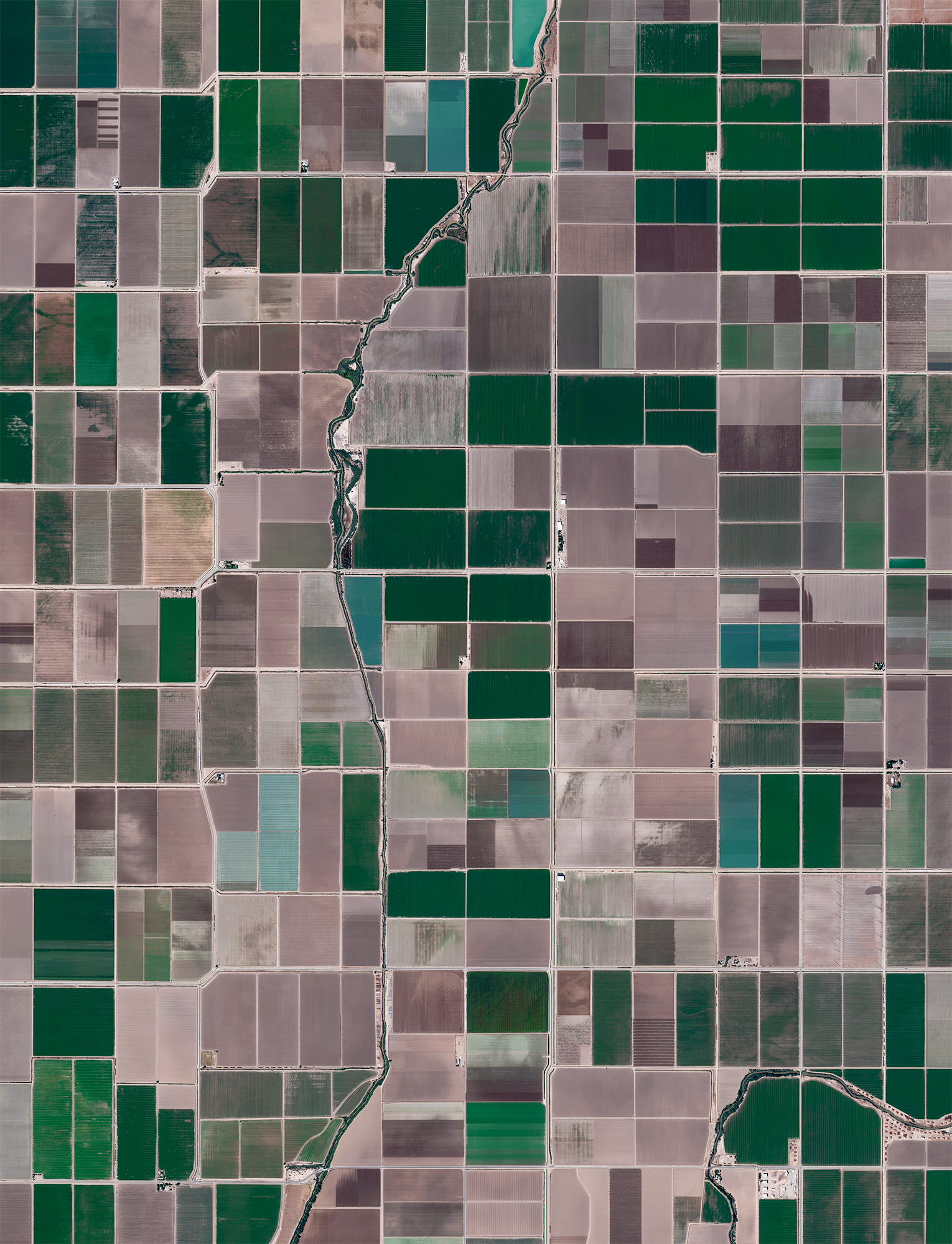 Agricultural development is seen in Calipatria, California, USA. At an elevation of 180 feet (55 m) below sea level, the city has the lowest elevation in the western hemisphere.  33.11641, -115.62727