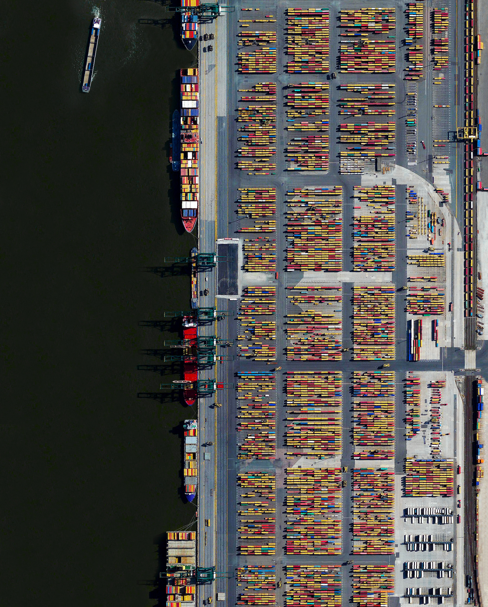 The Port of Antwerp in Belgium is the second largest seaport in Europe. In one year alone the facility handles more than 71,000 vessels and 314 million tons of cargo. That weight is roughly equal to 68% of the mass of all living humans on the planet.    51.322990, 4.326734
