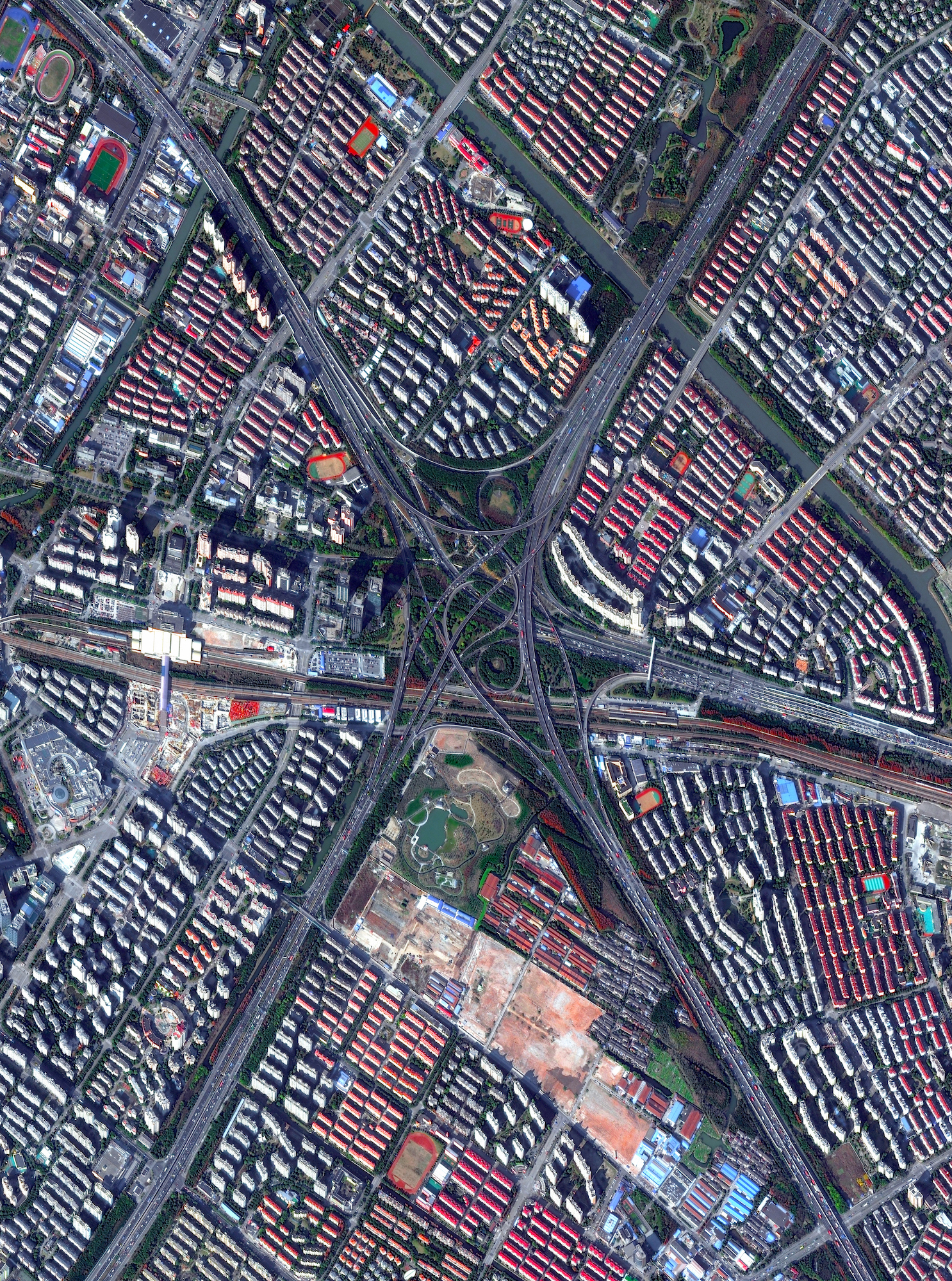 A highway interchange connects three major roads - the S20, G60, and S4 - in Shanghai, China. The city is home to roughly 2.5 million cars and 24 million people.  31.11892, 121.38823