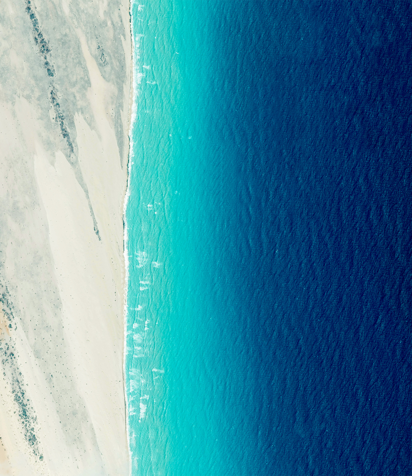 Waves roll into the shores of Somalia, by the village of El Hur. Located on the Horn of Africa, Somalia has the longest coastline on the mainland continent, stretching for more than 3,000 kilometers (1880 miles).  5°00′N 48°16′E