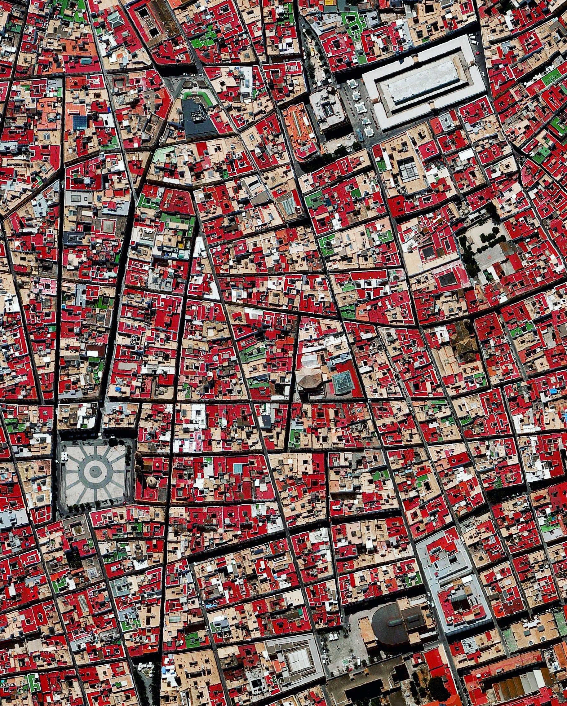 """Cádiz is an ancient port city surrounded by the sea in southwest Spain. Because the city was constructed upon a spit of land that cannot support high-rises, its skyline has not substantially changed since medieval times. A portion of the """"Old City"""" — an area characterized by narrow winding alleys connecting large plazas and markets — is seen in this Overview.  36.531514, -6.299827"""