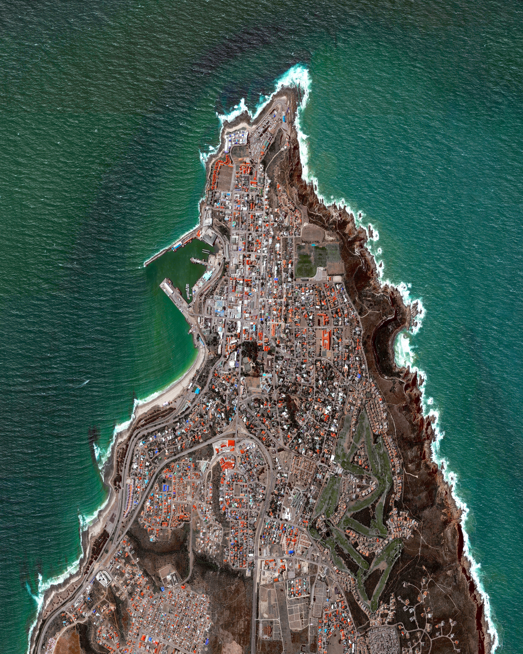 Mossel Bay is located on the Cape St. Blaize Peninsula, jutting out into the Indian Ocean of South Africa. The harbor town is home to roughly 130,000 people and is recognized as a center for both tourism and agriculture.  34°11′00″S 22°08′00″E
