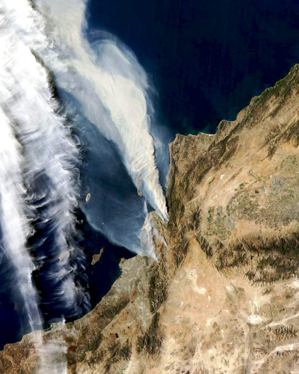 Wildfires, visible at center, are currently burning in Ventura, California. Numerous blazes have already destroyed hundreds of homes and thousands of residents have fled the surrounding areas. The largest fire has expanded to cover an area roughly the size as the city of Orlando. To be very clear, the two white streaks seen here at left are cloud cover, not fires.  34°16′30″N 119°13′40″W  Source imagery: NASA Goddard Space Flight Center via the Esri ARCgis Platform