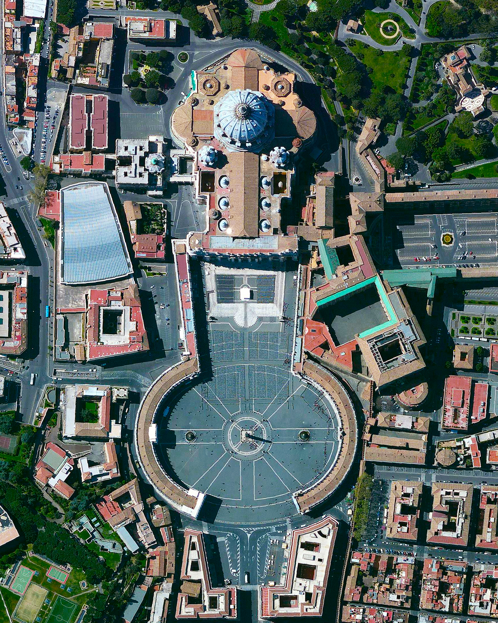 """Merry Christmas from Daily Overview! St. Peter's Basilica, located within Vatican City, is regarded as one of the holiest Catholic sites and one of the greatest churches in all of Christendom. And to everyone who unwrapped a copy of """"Overview"""" this morning, we hope you love it!"""
