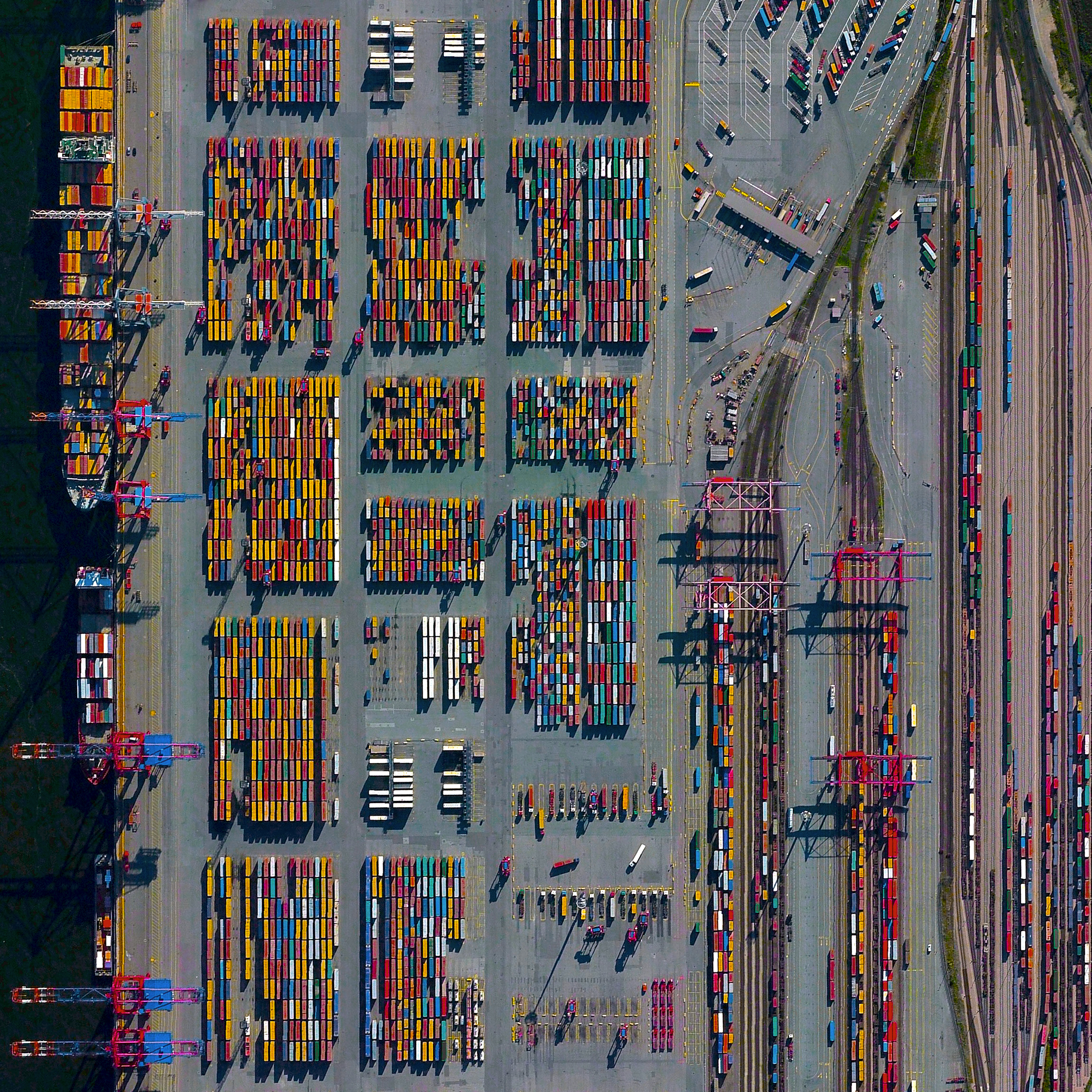 """The Port of Hamburg - known as Germany's """"Gateway to the World"""" - is located on the Elbe River in Hamburg. On an average day, the facility is accessed by 28 ships, 200 freight trains, and 5,000 trucks. In total, the port moves 132.3 million tonnes of cargo each year - that's roughly 1/3 of the mass of all living human beings.  53.532581146°, 9.916544334°"""