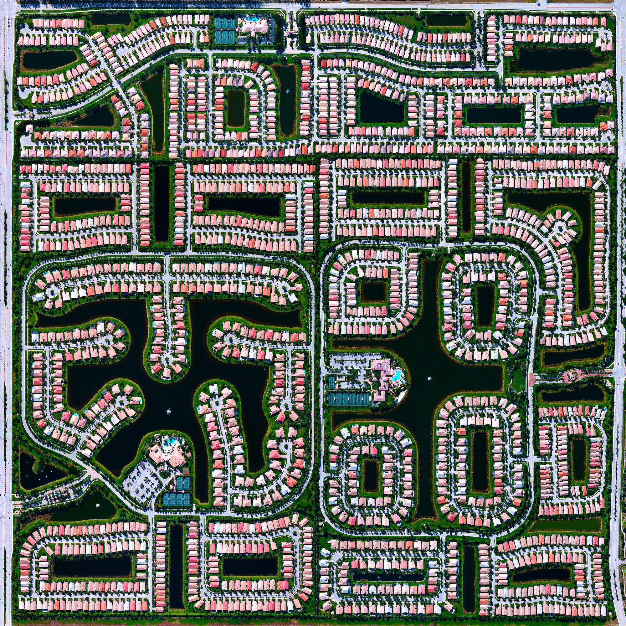 A residential community is seen here in Delray Beach, Florida, USA. Because many cities in the state of Florida contain master-planned communities, often built on top of waterways in the latter half of the twentieth century, there are a number of intricate designs such as this one that are visible from the Overview perspective.  26.475547616°, -80.156470216°