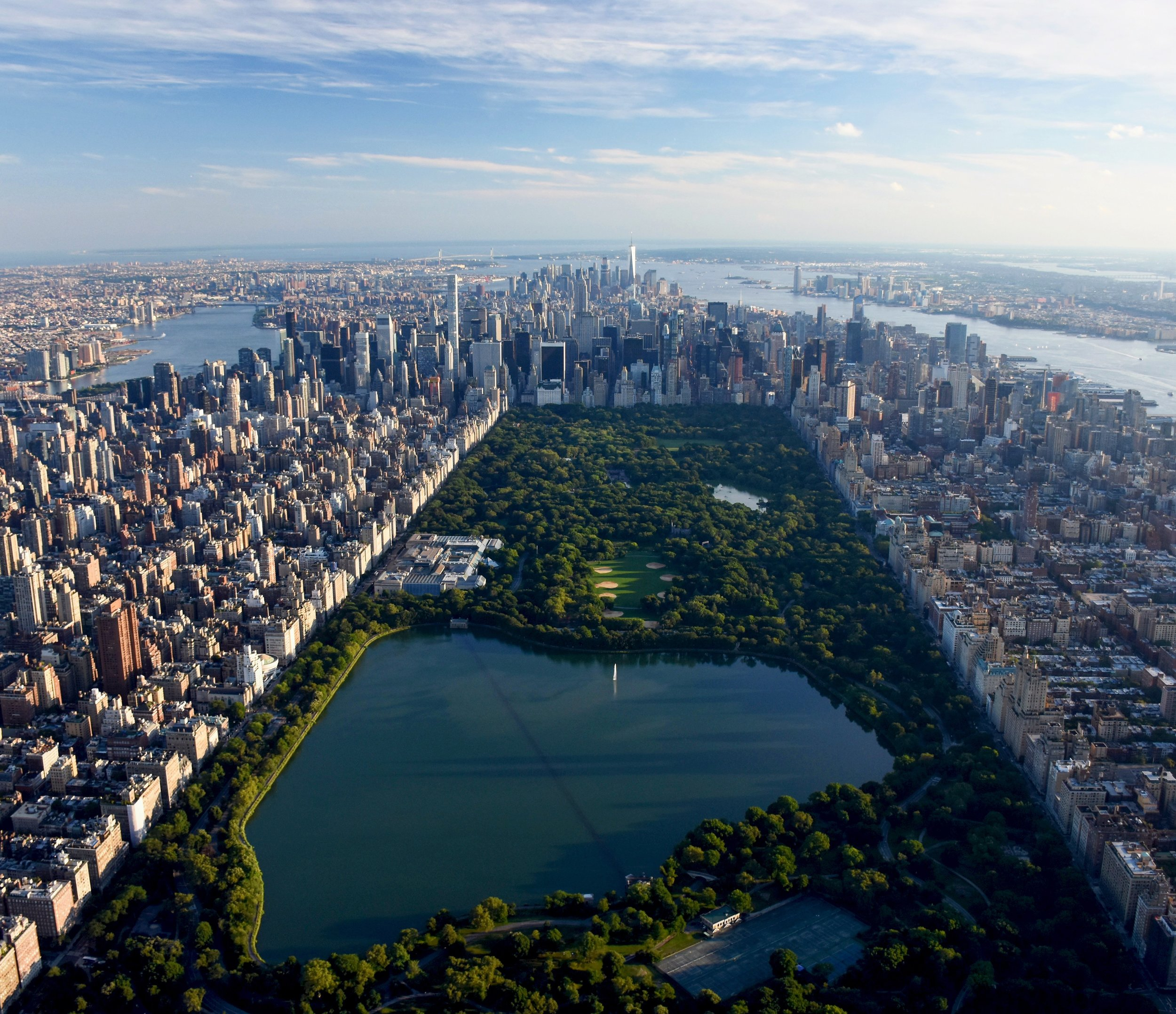 """Check out Central Park captured from helicopter by our founder Benjamin Grant. Located in the middle of Manhattan in New York City, the park spans 843 acres - or 6% of the borough. One of the most influential innovations in the park's design was its """"separate circulation"""" systems for pedestrians, horseback riders, and automobiles. This concealed """"crosstown"""" commercial traffic in sunken roadways, and densely planted shrub belts in order to maintain a rustic ambiance."""