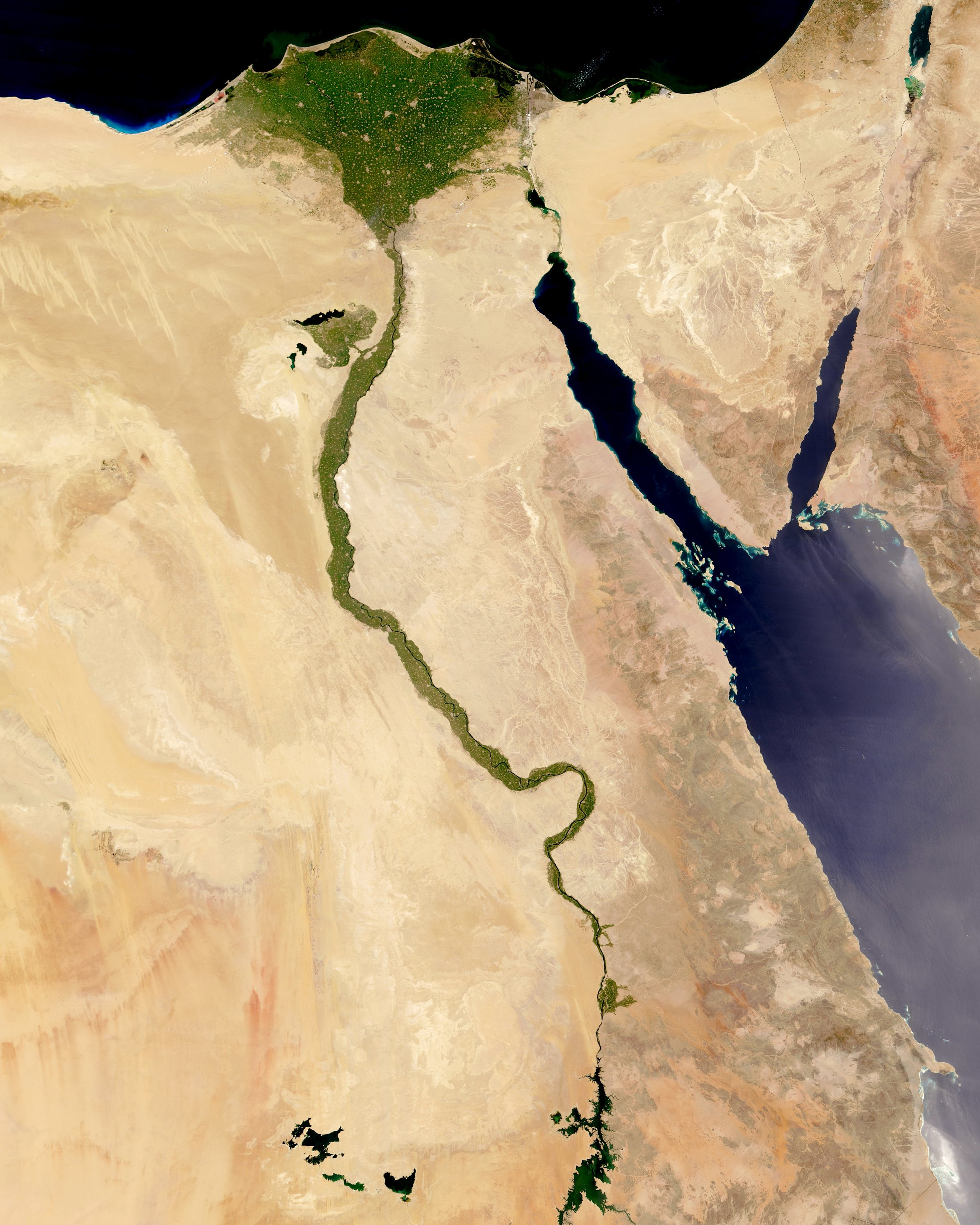 "The Nile River is commonly regarded as the longest river in the world, flowing for 4,258 miles (6,853 km) over 11 countries in northeastern Africa. In this Overview, it is shown flowing north through Egypt, forming a large triangular delta before emptying into the Mediterranean Sea. Civilizations since ancient times have depended on the waters of the Nile to flood and fertilize surrounding desert lands.  29°20'11.0""N, 31°13'28.8""E  Source imagery: NASA - National Aeronautics and Space Administration"