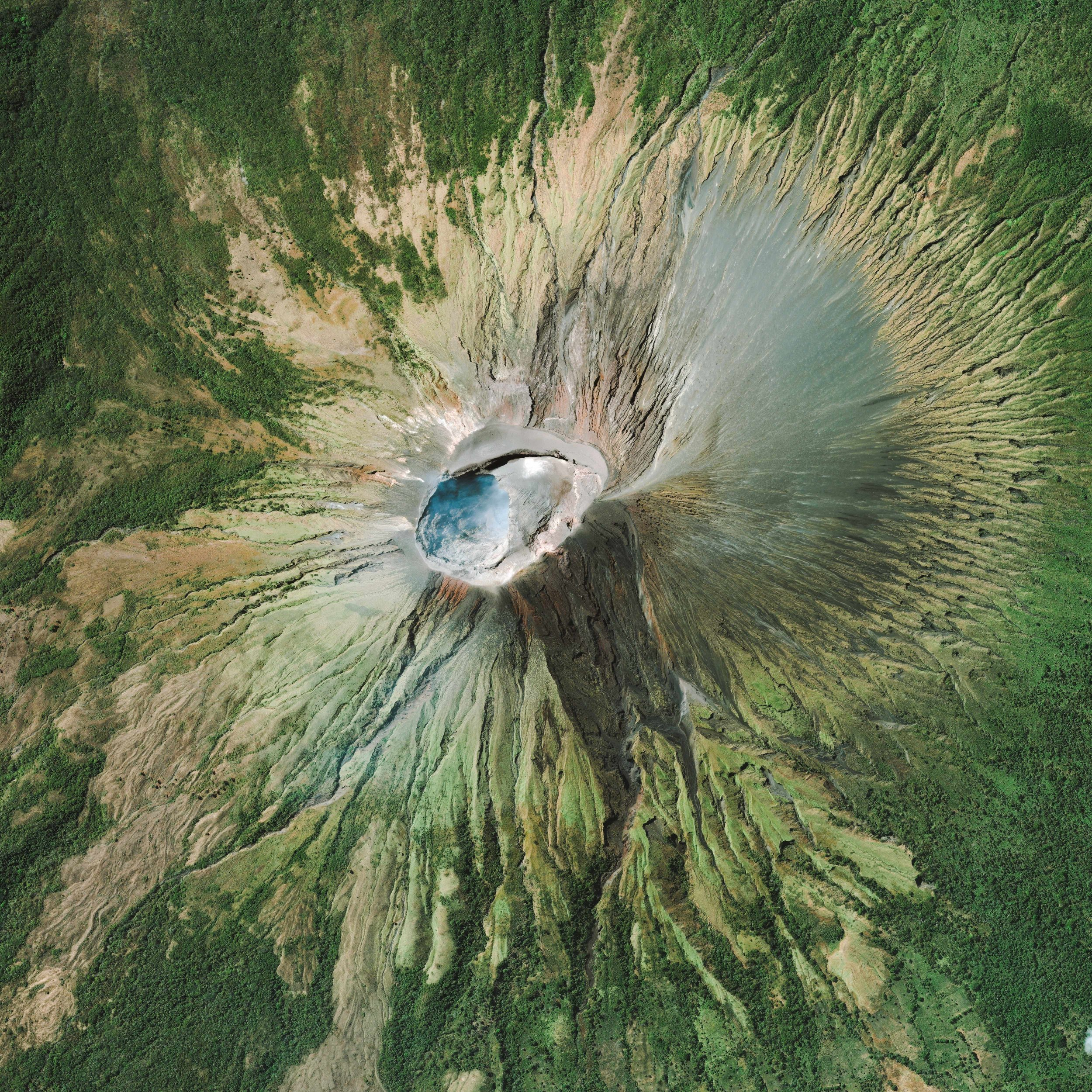 """San Cristóbal Volcano is the highest and one of the most active volcanoes in Nicaragua. Standing at 5,725 feet (1,745 m), it is located in the northwest corner of the country near the city of Chinandega. San Cristóbal has been consistently active since 1997, including an eruption on Christmas Day in 2012 that caused hundreds of nearby residents to evacuate.  12°42'13.8""""N, 87°00'02.8""""W  Source imagery: DigitalGlobe"""