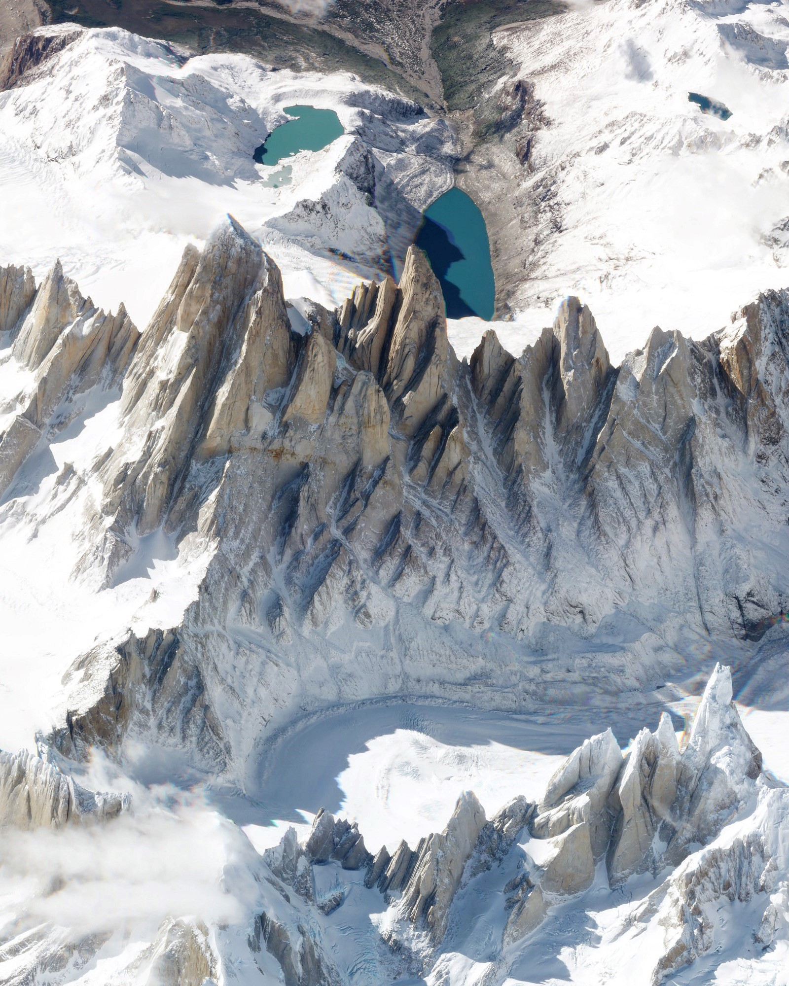 """Check out this amazing view of Monte Fitz Roy — a mountain in the Patagonia Region on the border of Argentina and Chile — captured by a Planet Labs satellite at a low angle. With an elevation of 11,171 ft (3,405 m) and sheer granite faces, it is one of the most technically challenging mountains to ascent on Earth. Monte Fitz Roy is also the inspiration for the Patagonia clothing company's logo.  49°16'17.1""""S, 73°02'33.9""""W  Source imagery: Planet Labs"""