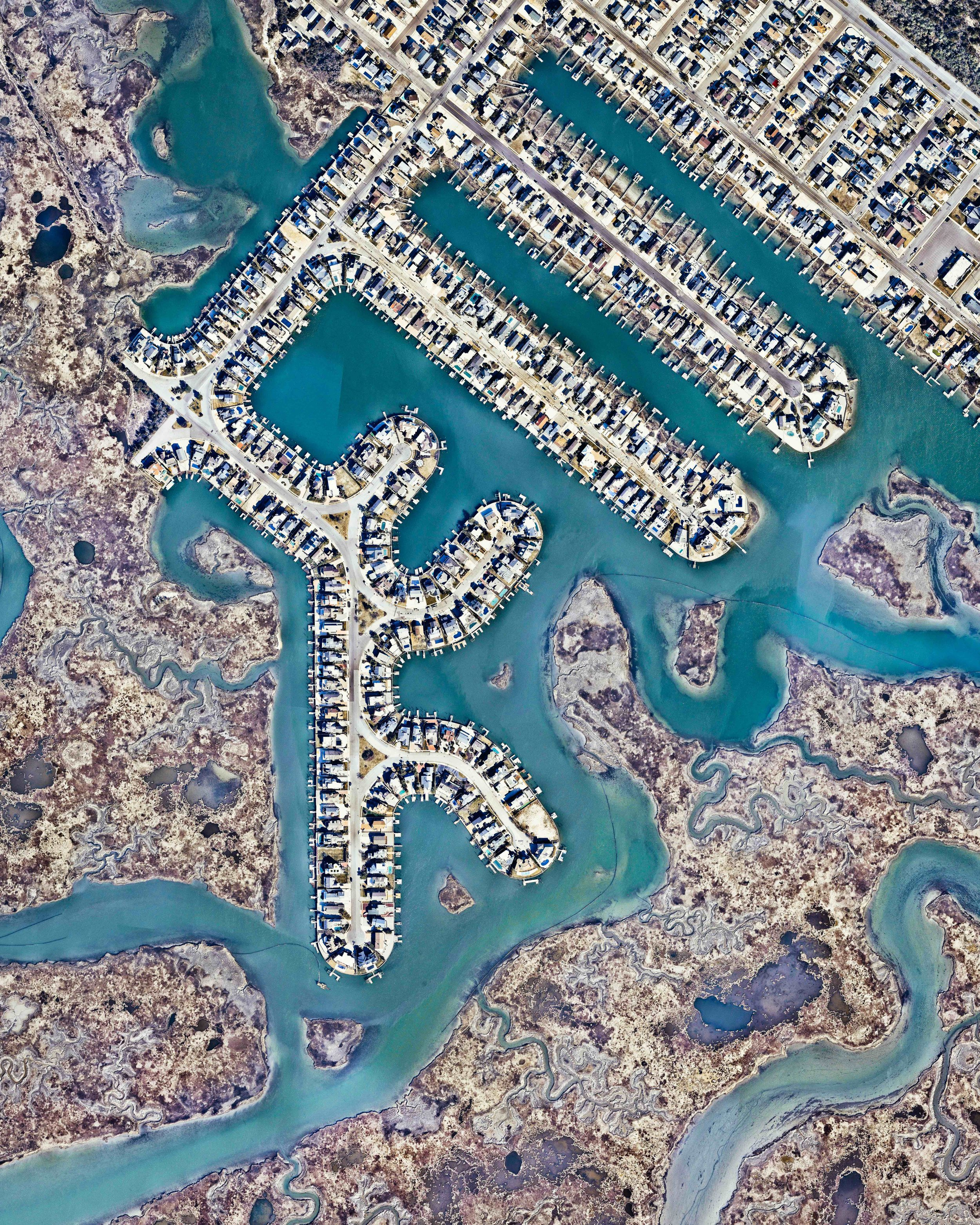 """Cottages line the waterways of Avalon, a coastal community in Cape May County, New Jersey. Avalon is home to some of the most expensive real estate on the East Coast of the United States.  39°05'20.0""""N, 74°44'18.9""""W  Source imagery: Nearmap"""