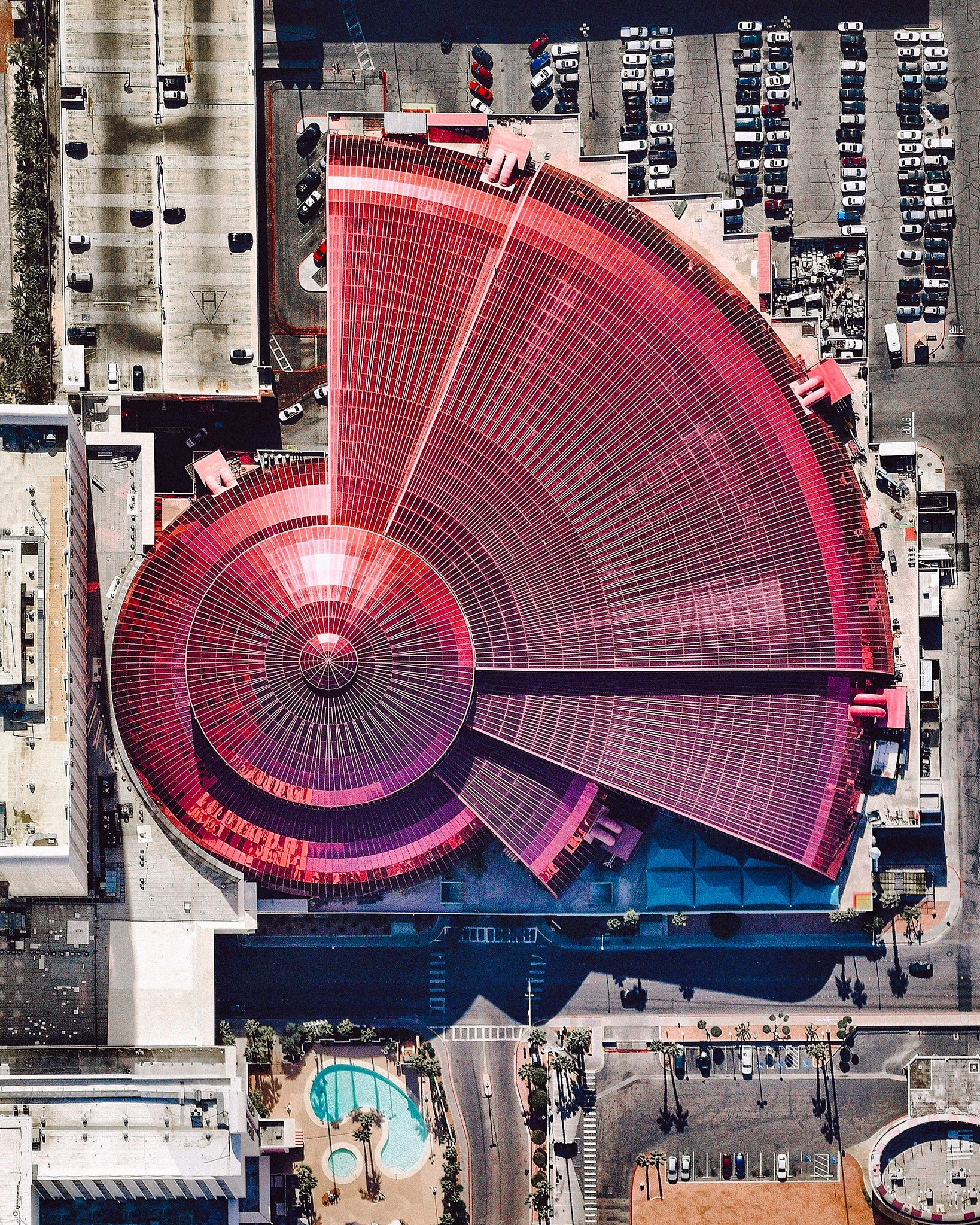 """Adventuredome is a five-acre indoor amusement park on the Las Vegas Strip in Nevada, USA. The facility's main structure consists of more than 350,000 square feet of pink insulated glass. Inside are two roller coasters, a water ride, rock climbing wall, 18-hole miniature golf course and dozens of carnival games.  36°08'17.0""""N, 115°10'02.6""""W  Source imagery: Nearmap"""
