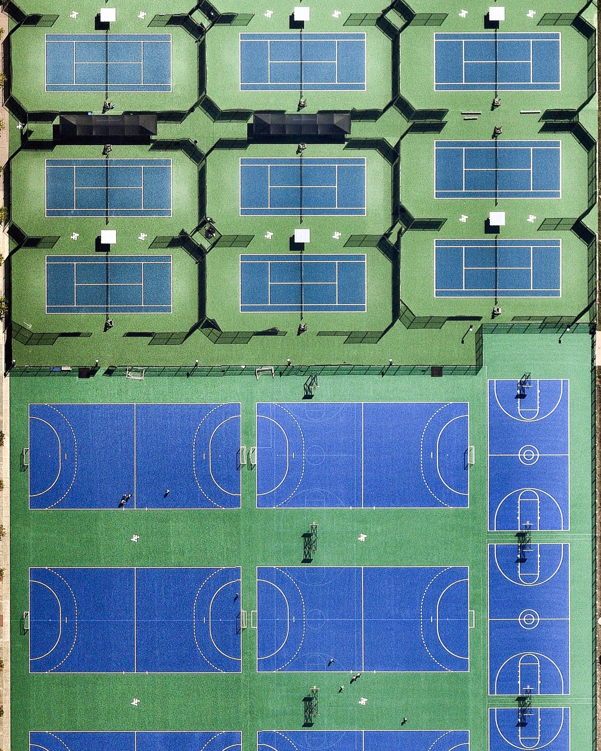 """Several athletic fields are positioned side-by-side in the Cadet Area of the United States Air Force Academy, in Colorado Springs, Colorado. In addition to the fields and courts shown in this Overview, the area contains a Cadet Gymnasium with indoor basketball and tennis courts, an Olympic-size swimming and diving pool, a water polo pool, numerous squash and racquetball courts, two weight-training rooms, and specialized facilities for volleyball, fencing, gymnastics, boxing, and riflery.  39°00'43.2""""N, 104°53'13.3""""W  Source imagery: Nearmap"""