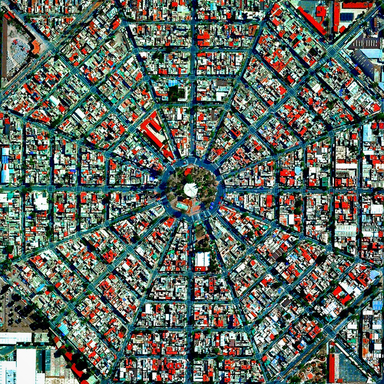 """Radiating streets surround the Plaza Del Ejecutivo in the Venustiano Carranza district of Mexico City, Mexico. This district — which is home to more than 430,000 people — contains three of Mexico City's large traditional markets, including La Merced, Mercado de Sonora, and Mercado Jamaica.  19°25'11.6""""N, 99°05'16.9""""W  Source imagery: DigitalGlobe"""