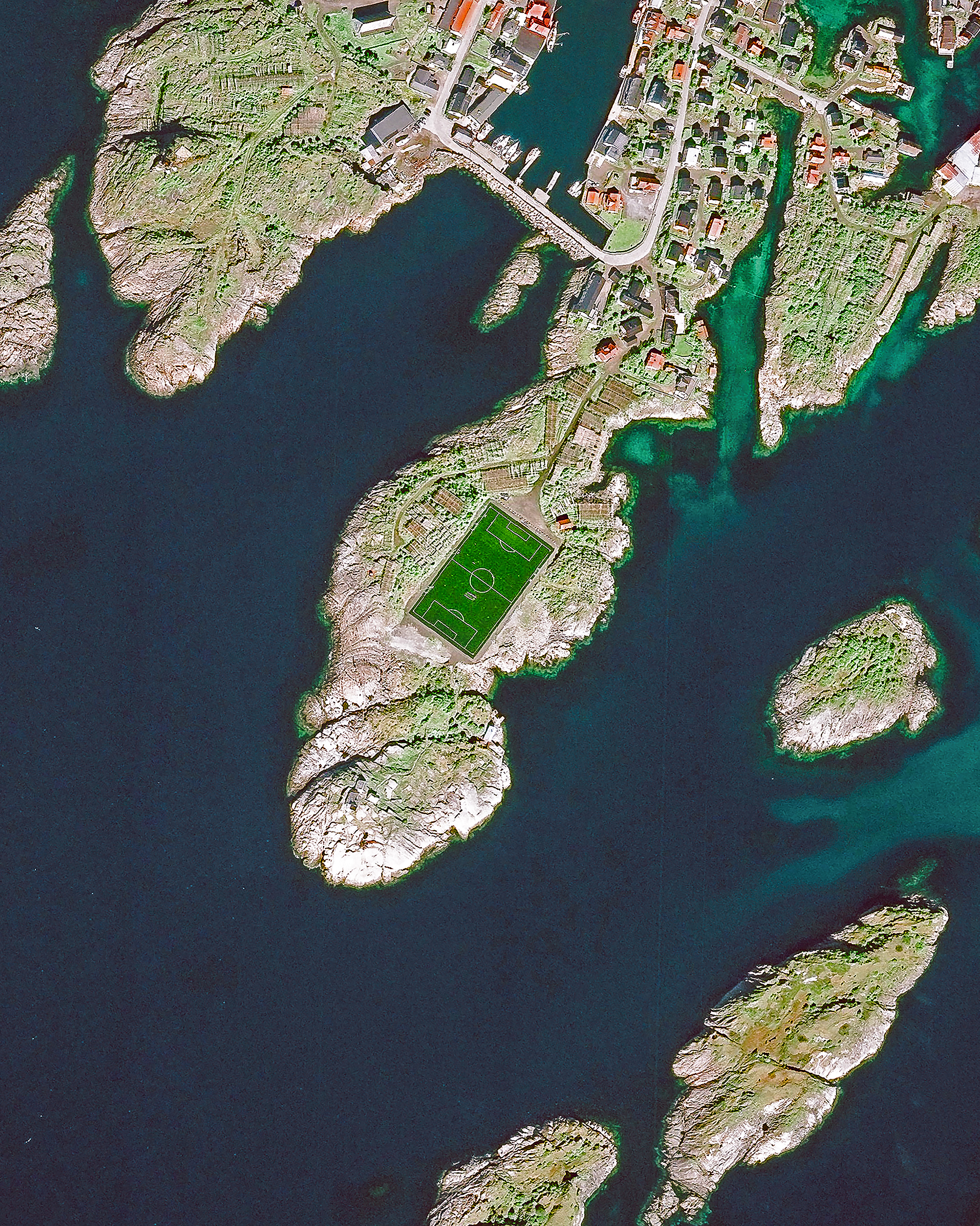 """Check out this unique soccer pitch in Henningsvær, a fishing village located on several small islands in Norway's Lofoten archipelago. Situated inside the Arctic Circle, this 74-acre (0.3 sq. km) village has a population of less than 500 people. Henningsvær is a popular tourist destination, attracting hikers, climbers, divers and snorkelers.  68°08'57.1""""N, 14°12'07.7""""E  Source imagery: DigitalGlobe"""