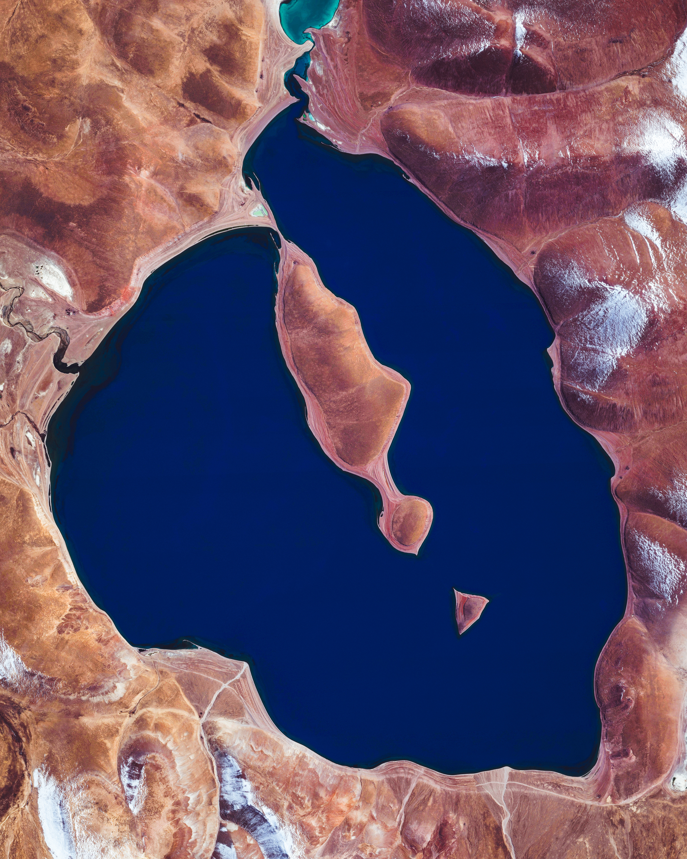 """The ultramarine waters of Lake Cuowomo add color to the landscape in Ngamring County, a remote section of the Tibet Autonomous Region in China. This lake, among others in Tibet, were favorite sites of NASA Astronaut Scott Kelly during his """"Year in Space"""" mission in 2015-16.  29°47'39.2""""N, 86°56'27.0""""E  Source imagery: DigitalGlobe"""