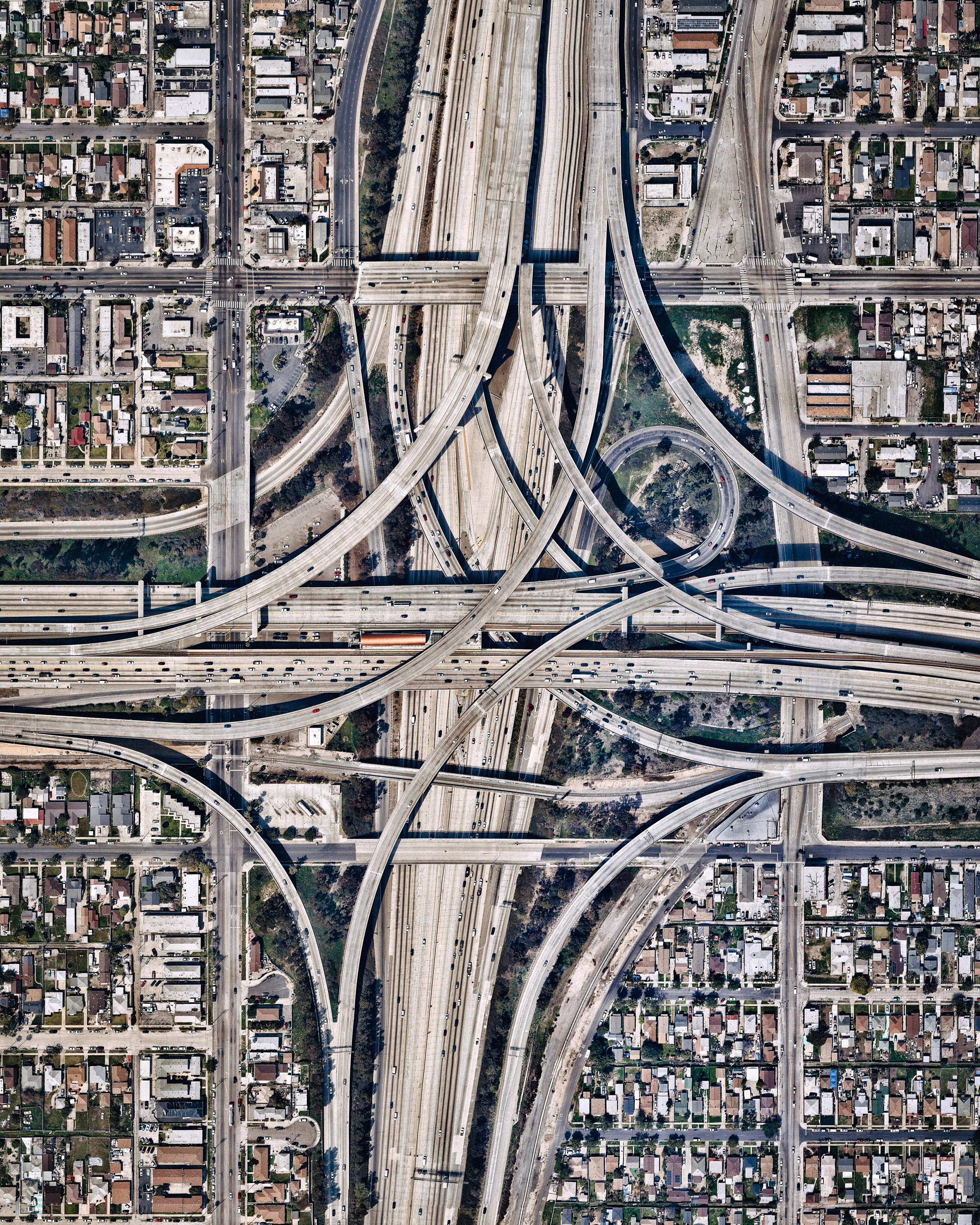 """The Judge Harry Pregerson Interchange is a 130-foot-tall (40 m) stack interchange near the Athens and Watts communities of Los Angeles, California. It is formed by the intersection of Interstate 105 (Glenn M. Anderson Freeway) and Interstate 110 (Harbor Freeway). For a full weekend in 2015, one of the interchange ramps was closed for filming the opening musical number of """"La La Land.""""  33°55'44.1""""N, 118°16'50.1""""W  Source imagery: Nearmap"""