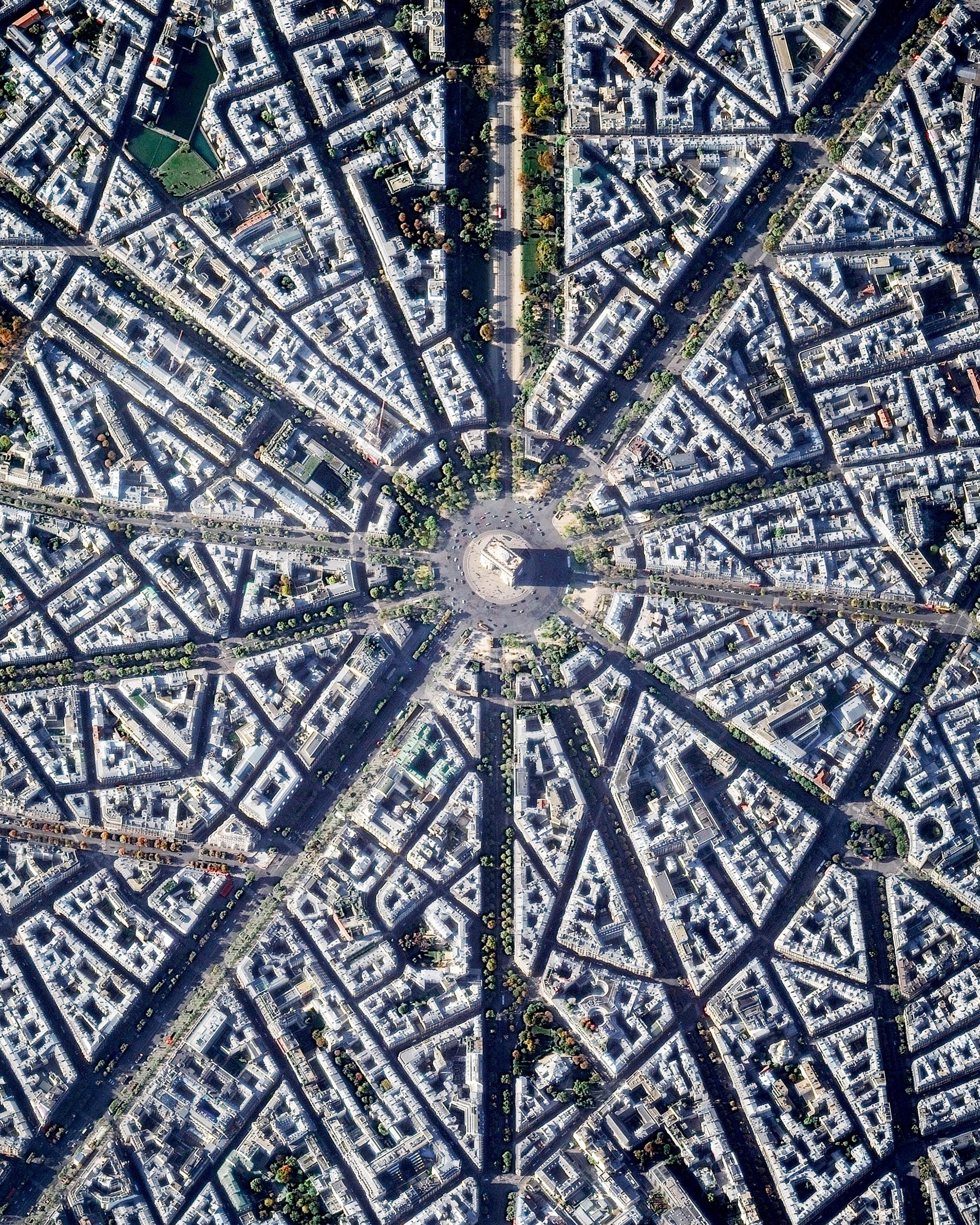 """The Arc de Triomphe is located at the center of 12 radiating avenues in Paris, France. Yesterday, millions took to these streets to celebrate France's second FIFA World Cup victory (with a 4-2 final win over Croatia). Today, players and coaches will parade up the Champs-Elysees avenue, which passes diagonally through this Overview from bottom left to upper right.  48°52'25.6""""N, 2°17'42.0""""E  Source imagery: DigitalGlobe"""