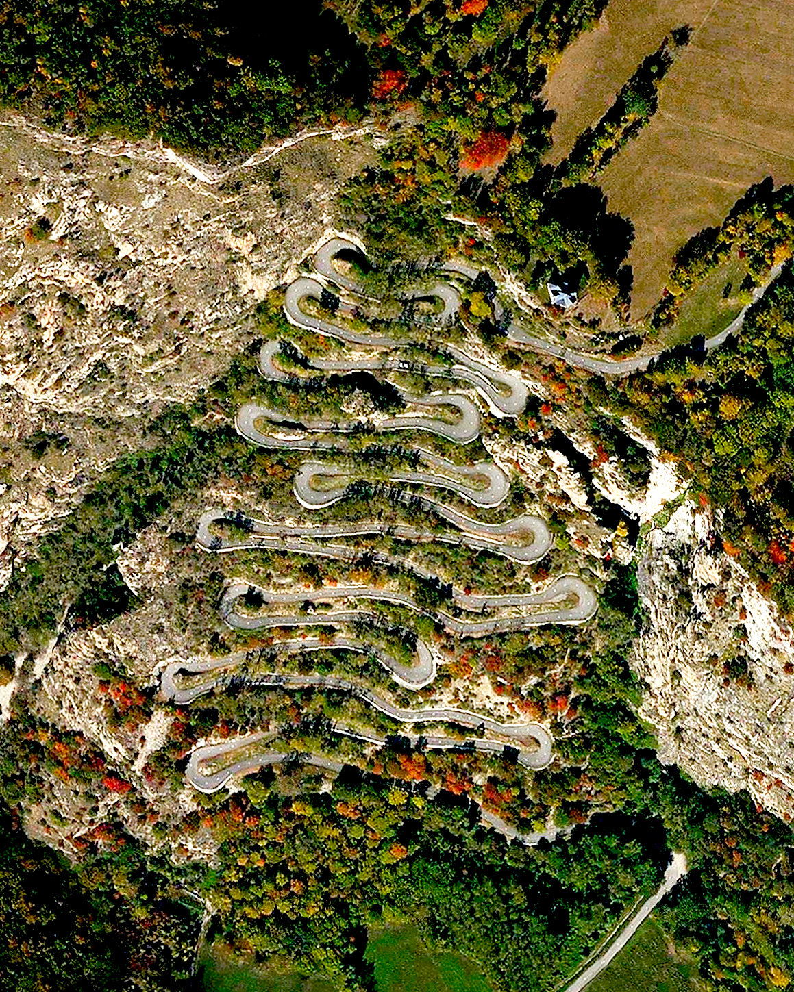 """On Thursday, cyclists racing in the Tour de France completed Stage 12 of the race, passing through the 18 hairpin turns of the Lacets de Montvernier in Montvernier, France. This spectacular climb is 2.1 miles long (3.4 km) and contains a switchback turn every 450 feet (150 m). Welsh cyclist Geraint Thomas, racing for Team Sky, won this stage in just under five hours and 20 minutes.  45°19'03.4""""N, 6°20'14.6""""E  Source imagery: DigitalGlobe"""
