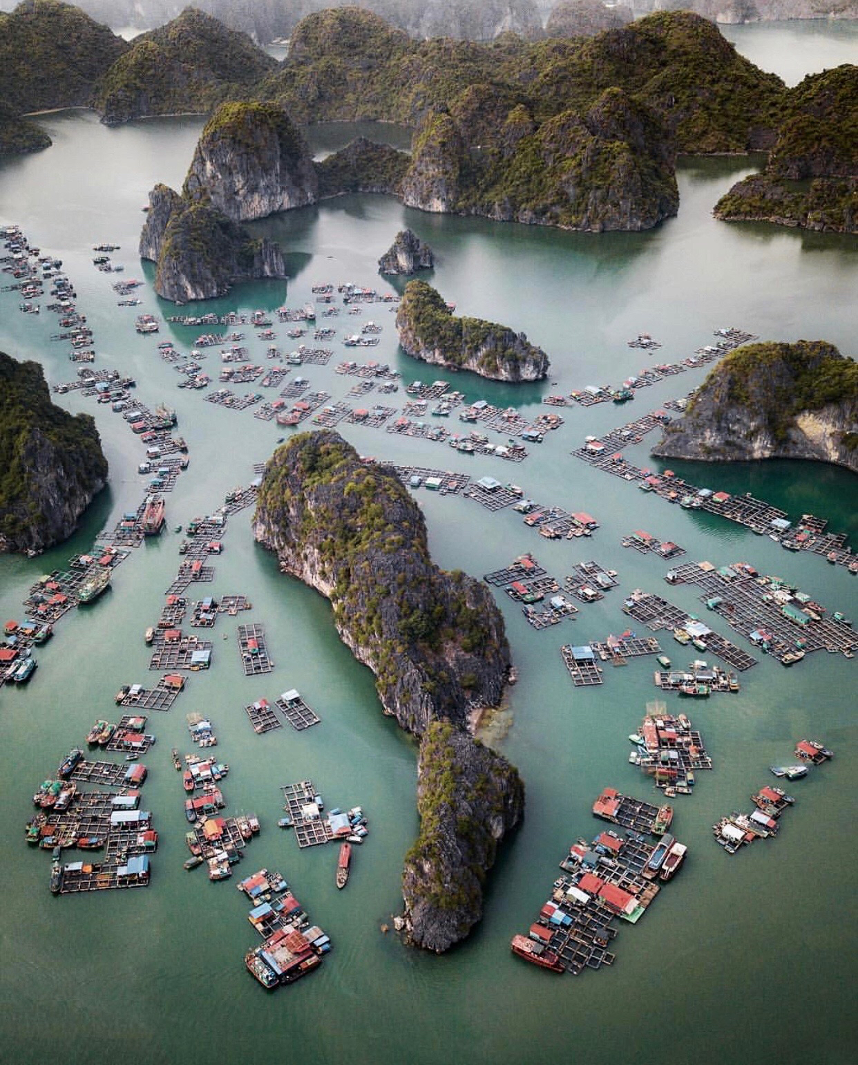 """Check out this week's """"Drone Sunday"""" post from From Where I Drone, which shows the Cát Bà Archipelago in northern Vietnam. It is made up of 367 islands that span 100 square miles (260 sq. km) in the southeastern edge of Lan Ha Bay. The largest island — also called Cát Bà — has roughly 13,000 inhabitants, with an additional 4,000 people living on floating fishing villages off the coast.  20°44'12.0""""N, 107°03'44.0""""E  Source imagery: @rcrdb"""