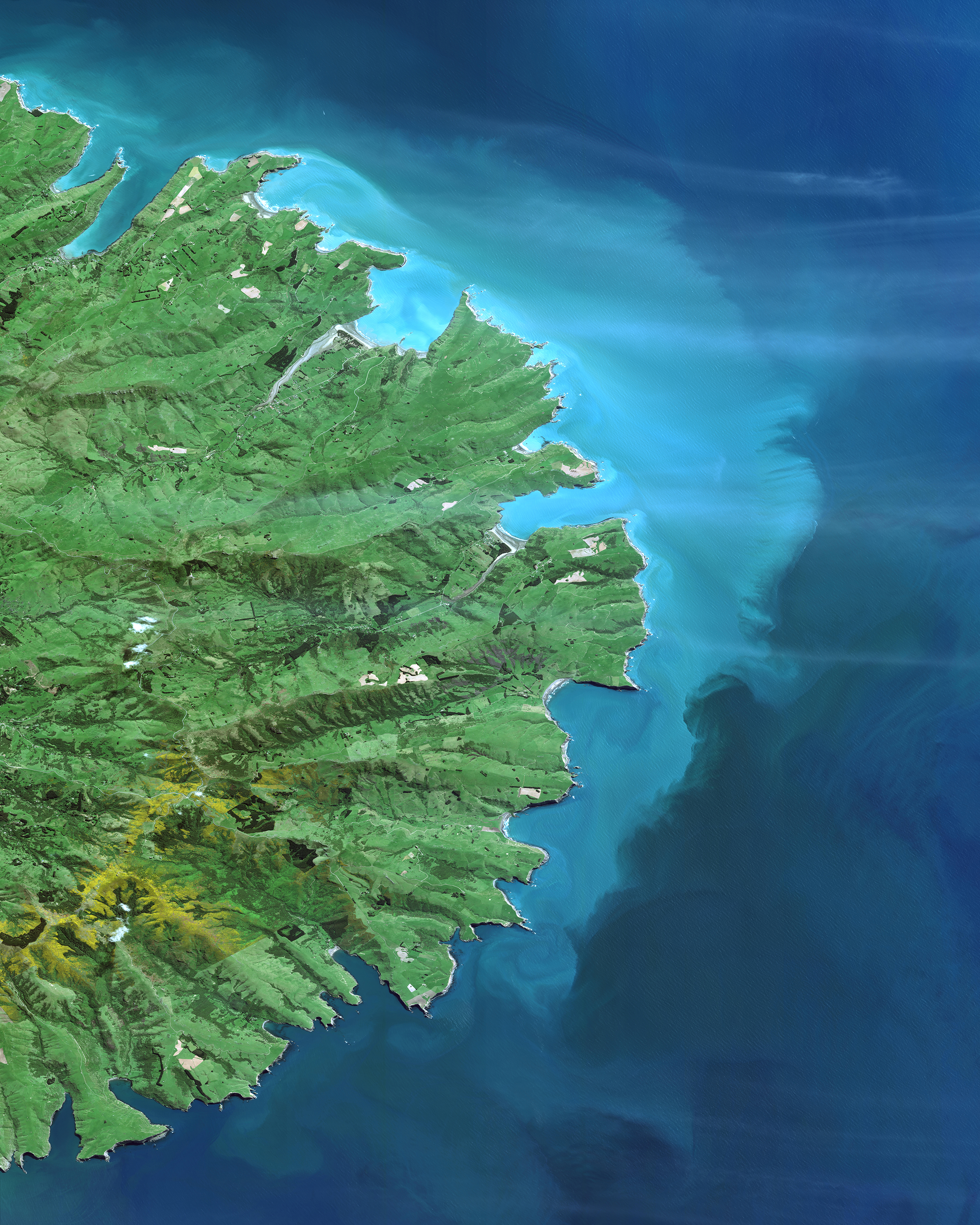 """Check out this amazing Overview of the Banks Peninsula, which juts off the east coast of New Zealand's South Island. The landmass, which is volcanic in origin, has an area of roughly 440 square miles (1,150 sq. km) and encompasses two large harbors and many small bays and coves. It is believed that forests once covered 98% of the Banks Peninsula, yet — as the result of deforestation — less than 2% of the native forest cover remains today.  43°45'00.0""""S, 172°49'58.8""""E  Source imagery: DigitalGlobe"""
