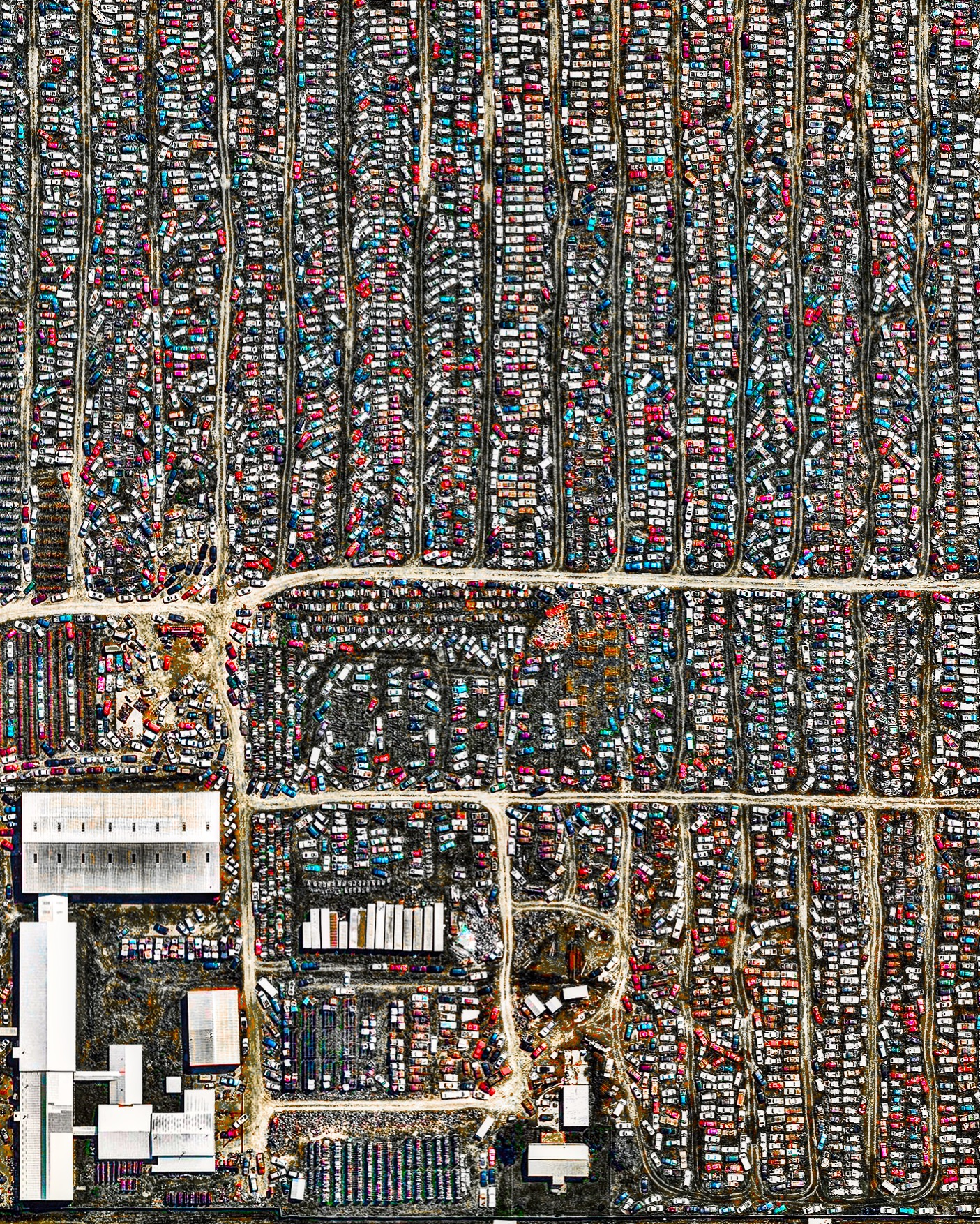 Thousands of vehicles are stored at a salvage yard in Rapid City, South Dakota, where they will be scrapped for usable parts and recycled back into raw materials. In the U.S. alone, between 12 and 15 million vehicles reach the end of their lives every year, making them the most-recycled consumer product in the nation. Currently, about 75% of all vehicle materials can be salvaged and recycled.  44.109263, -103.184094  Source imagery: Nearmap
