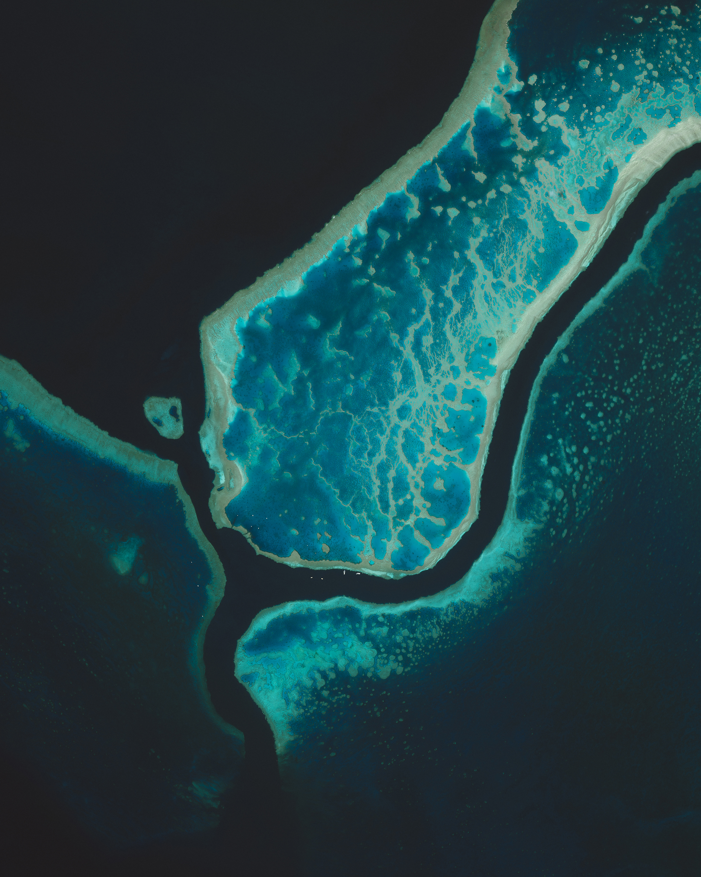 "This Overview captures a small segment of the Great Barrier Reef, located off the coast of Queensland, in northeastern Australia. Composed of more than 2,900 individual reefs and 900 islands, the reef system is Earth's largest structure made up of living things. The Great Barrier Reef stretches for more than 1,400 miles (2,300 km) and covers an area of roughly 130,000 square miles (344,400 sq. km).  18°17'10.0""S, 147°42'00.0""E  Source imagery: DigitalGlobe"